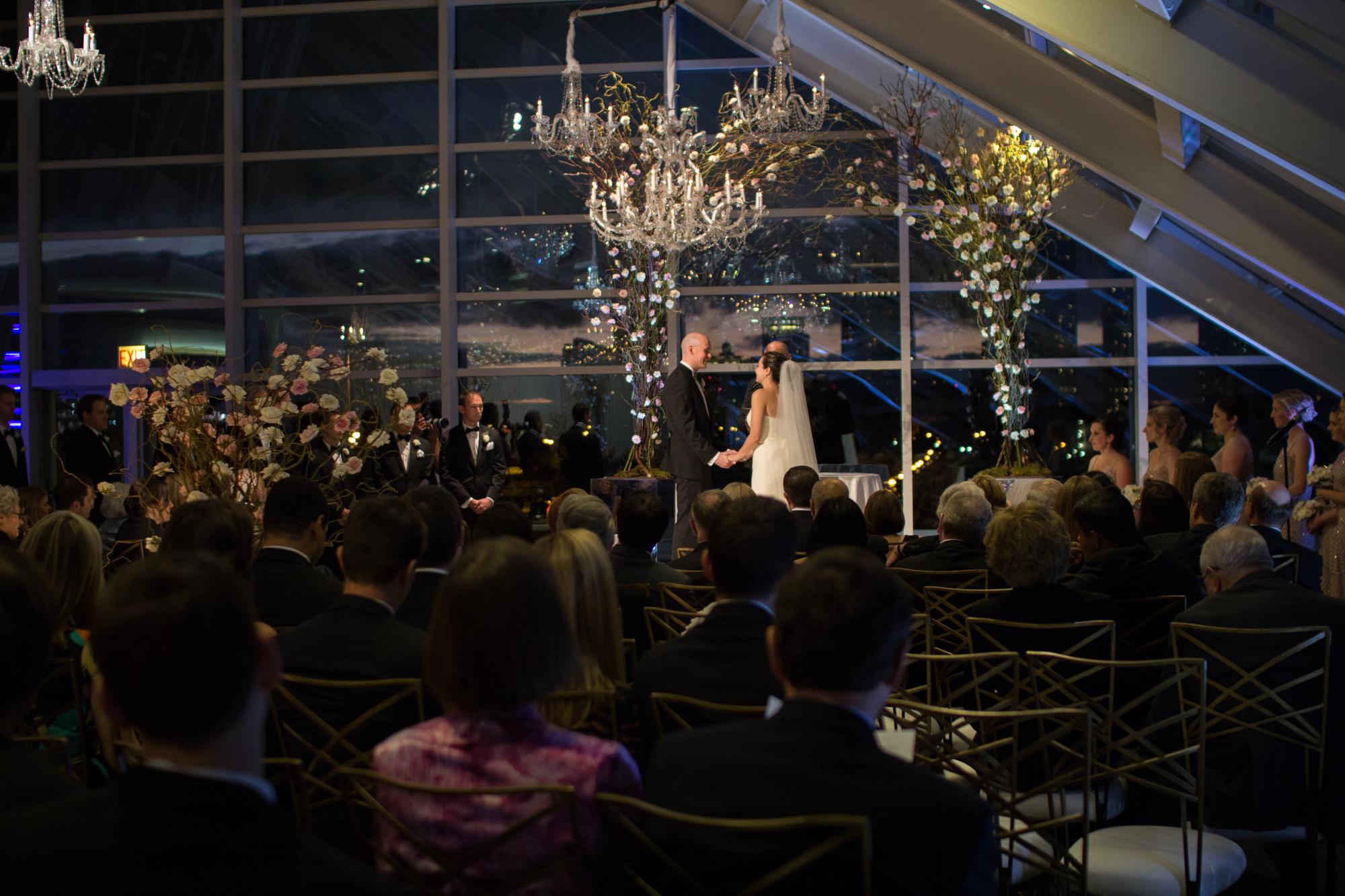 Evening wedding ceremony at Adler Planetarium in Chicago