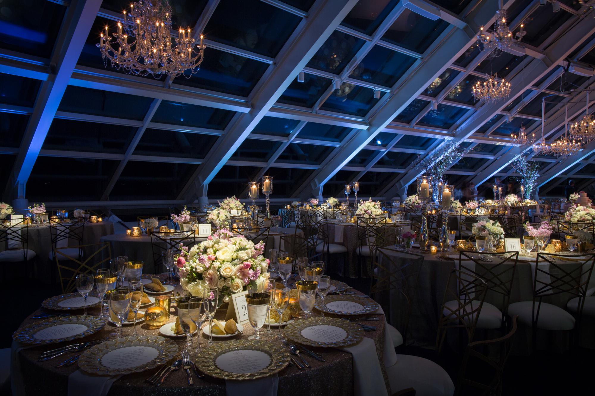 Stylish wedding reception at Adler Planetarium in Chicago.