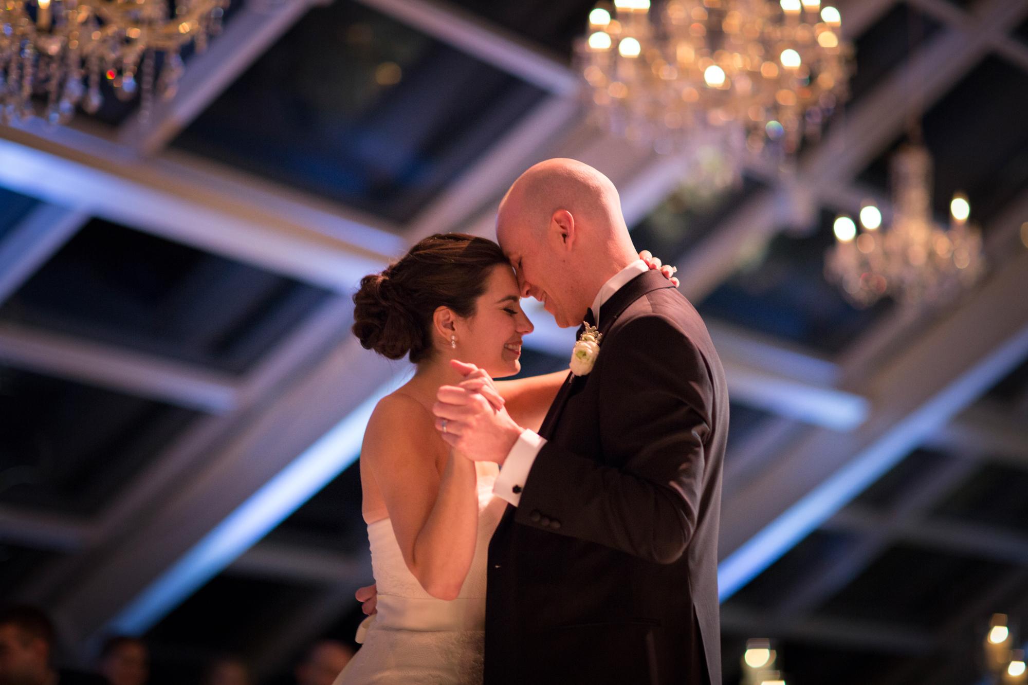 Bride and groom dance at Adler Planetarium wedding.