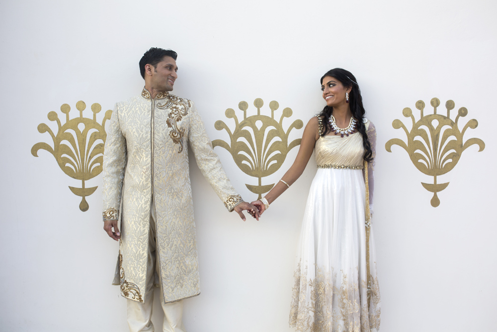 Portrait of bride and groom at South Asian destination wedding in Riviera Maya, Mexico.