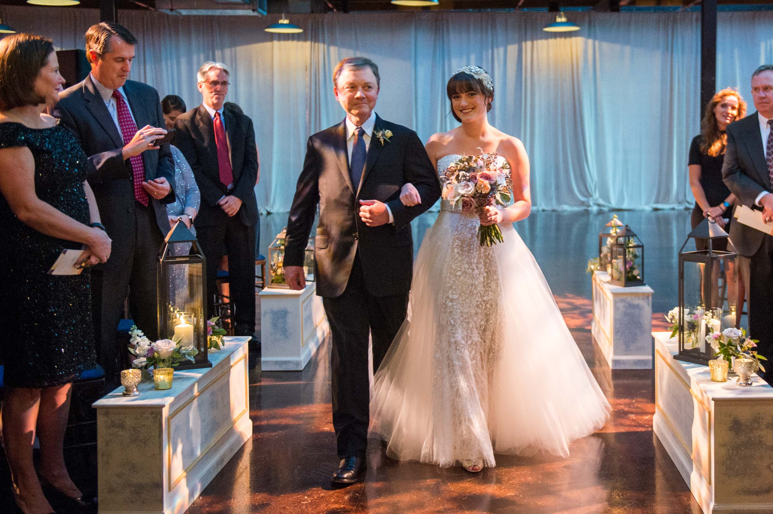 Bride and her dad walk down the aisle at Morgan Manufacturing wedding in Chicago