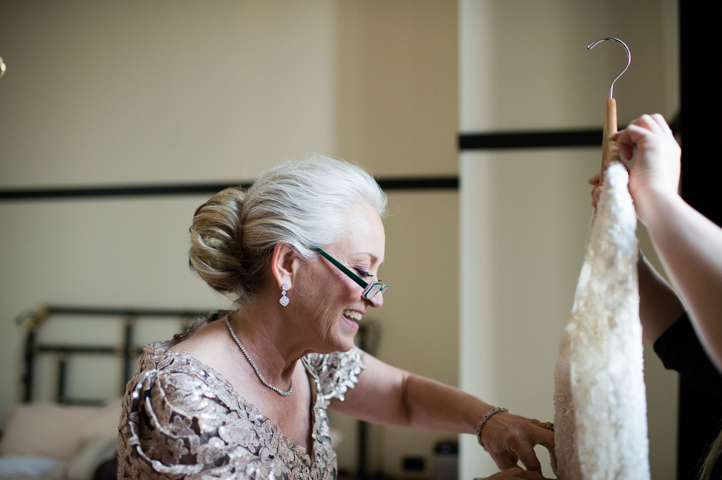 Bride's mother helps her get ready for wedding at Chicago Athletic Association.