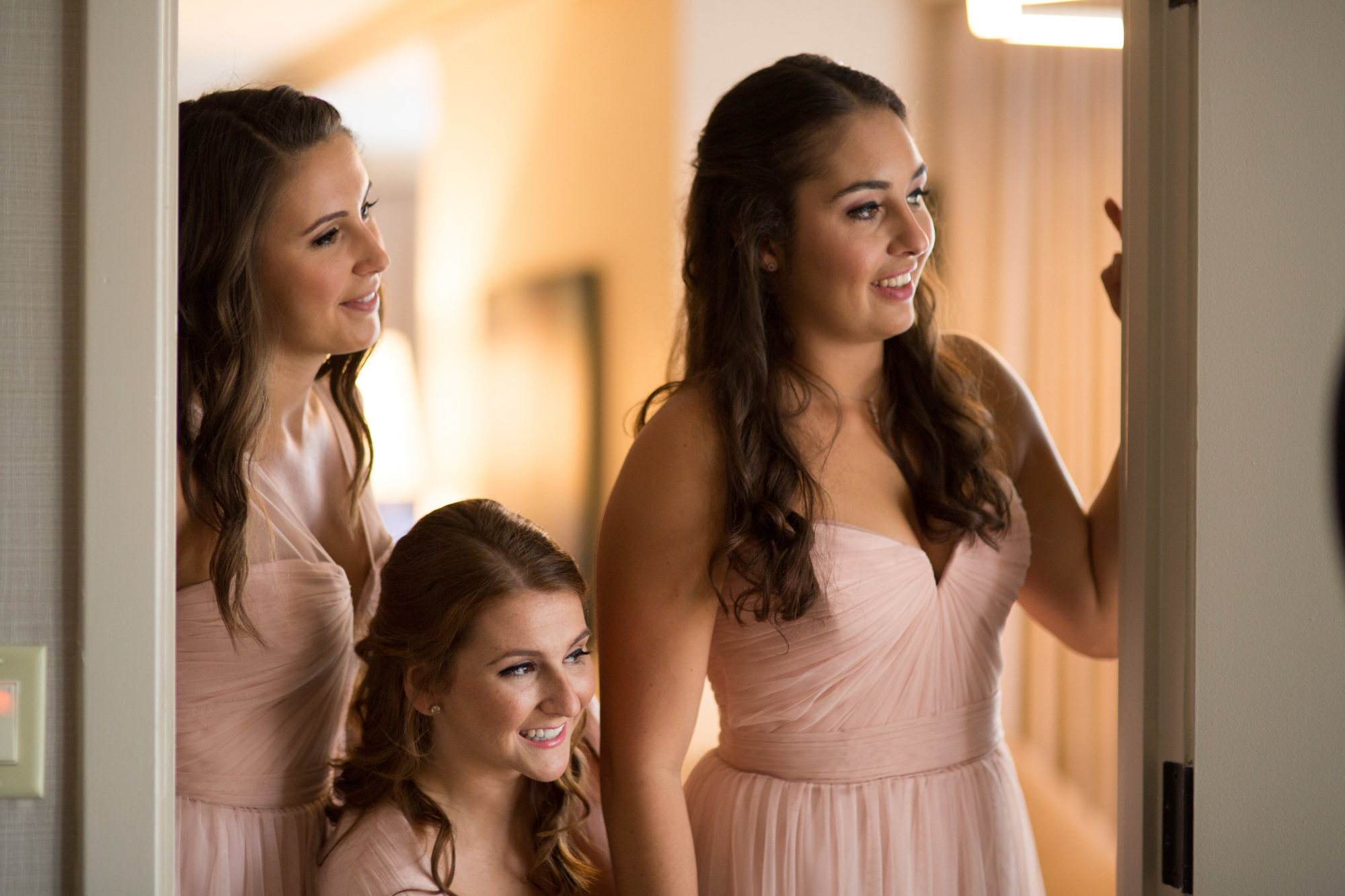 Bridesmaids seeing bride for the first time on her wedding day at Westin River North Chicago.