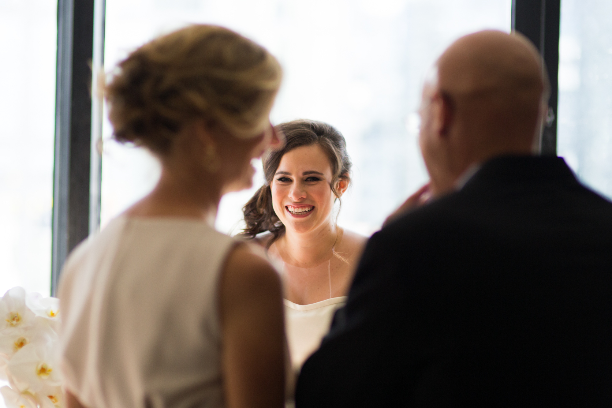 Documentary photography of bride and her parents seeing each other on her wedding day in downtown Chicago.