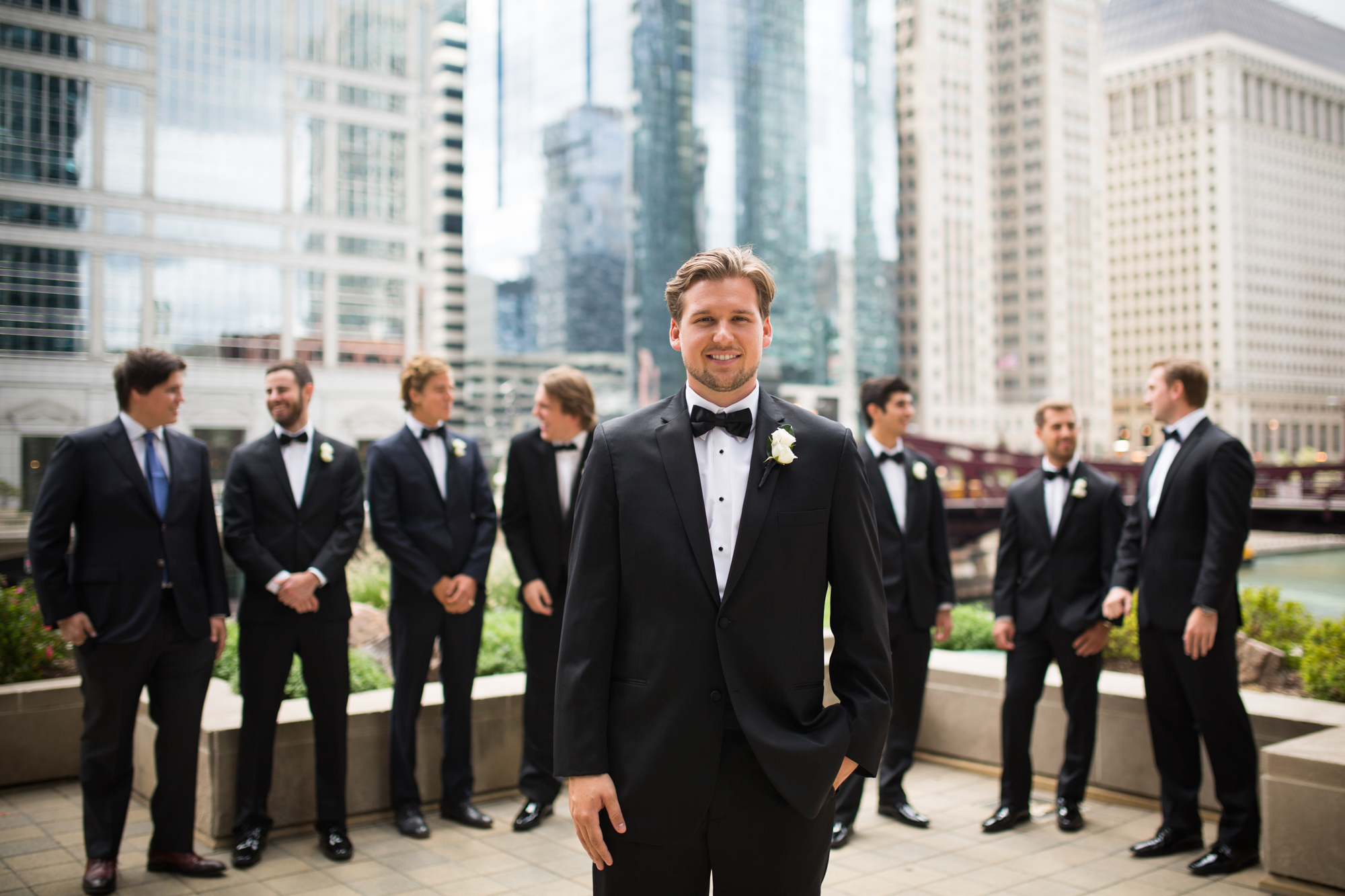 Groom and groomsmen portrait against Chicago skyline.