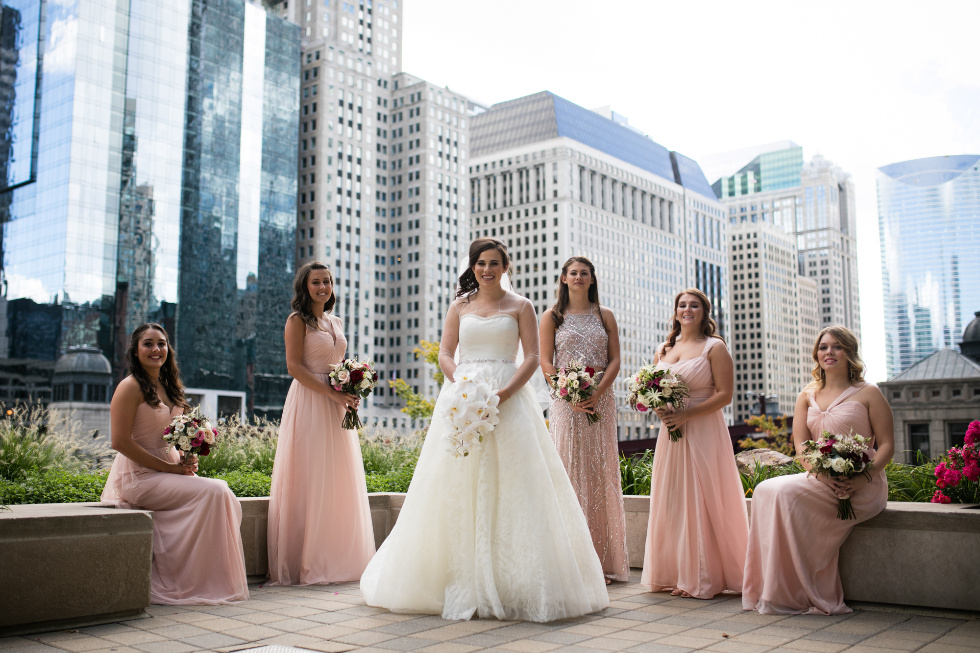 Portrait of bride and bridesmaids against Chicago skyline.
