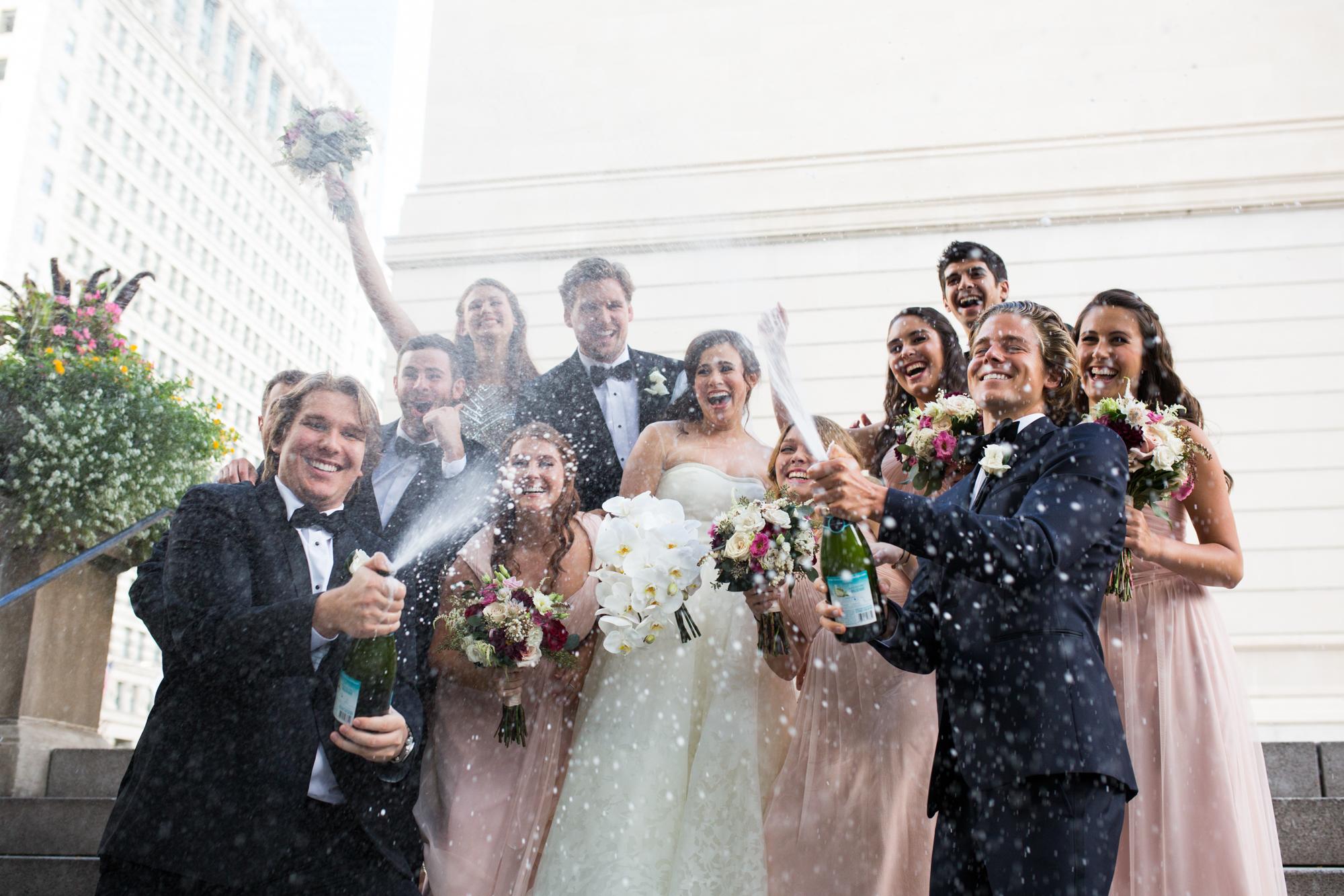 Wedding party spraying champagne at Chicago wedding