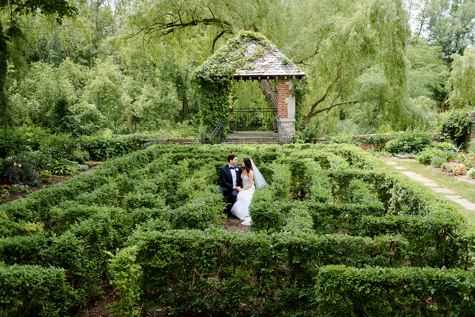 Wedding portrait of a couple in an english garden at the River Bend Club
