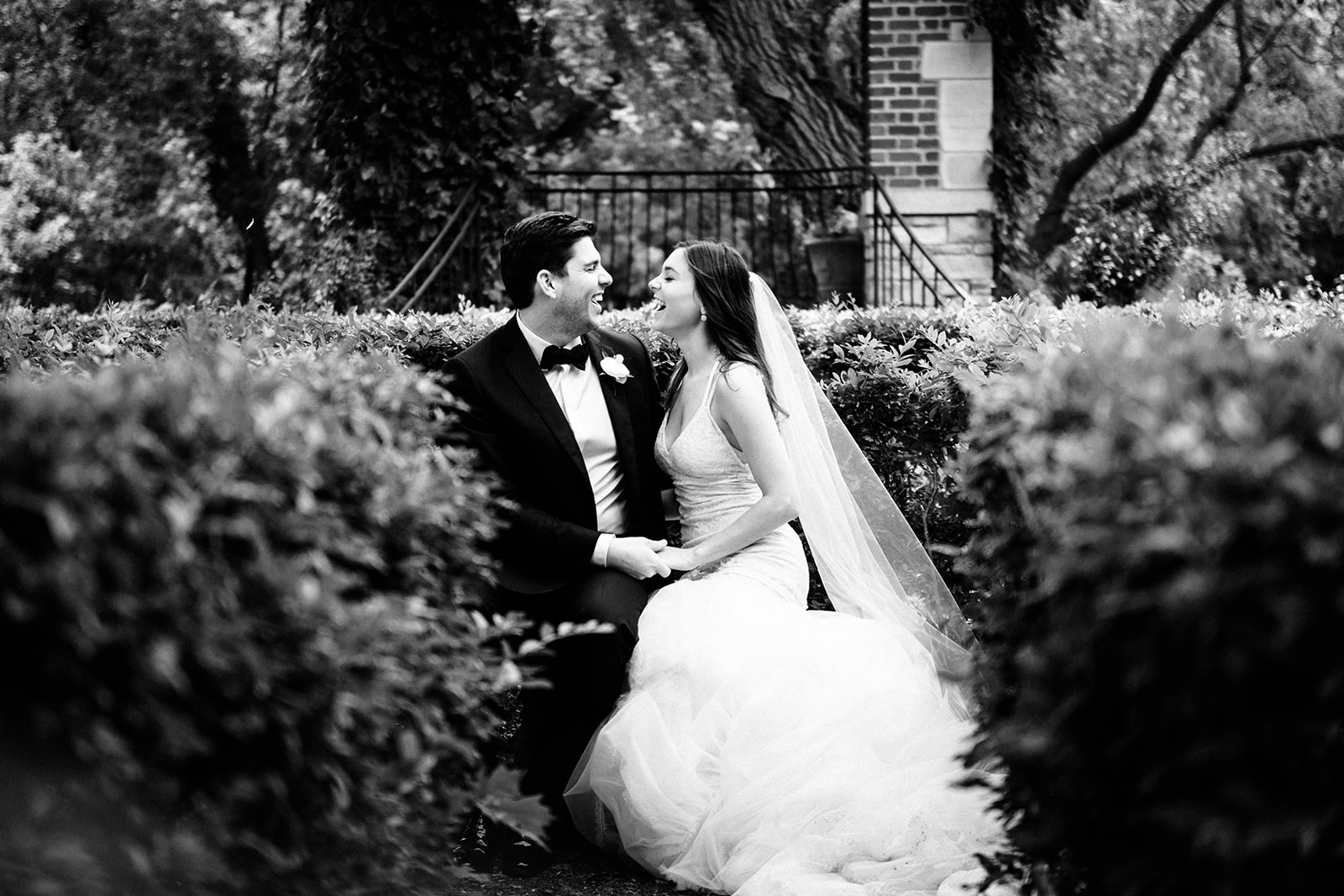 Documentary portraits of a bride and groom at their English garden wedding in Wisconsin.
