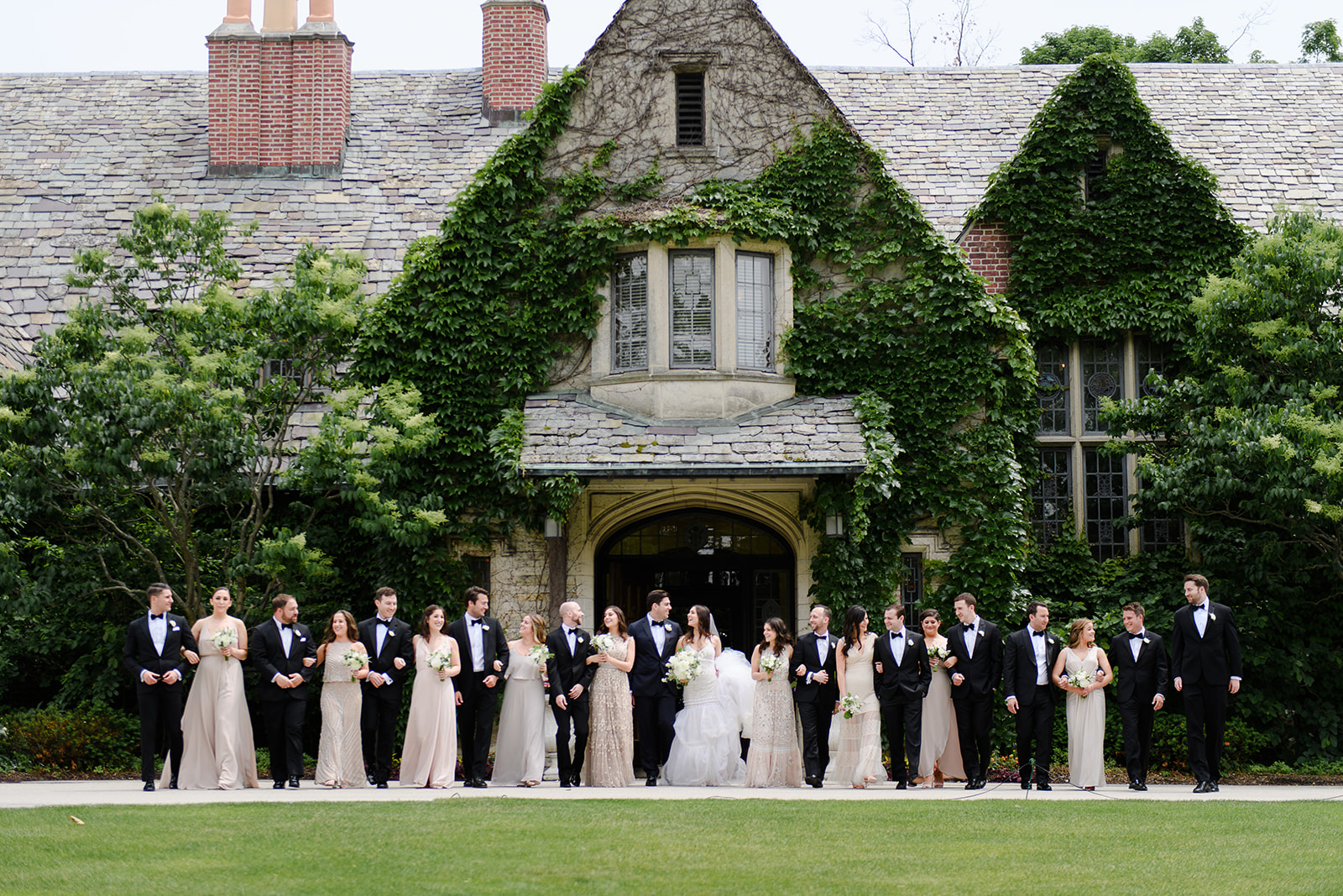 Wedding party in front of ivy mansion at Riverbend Club Wisconsin