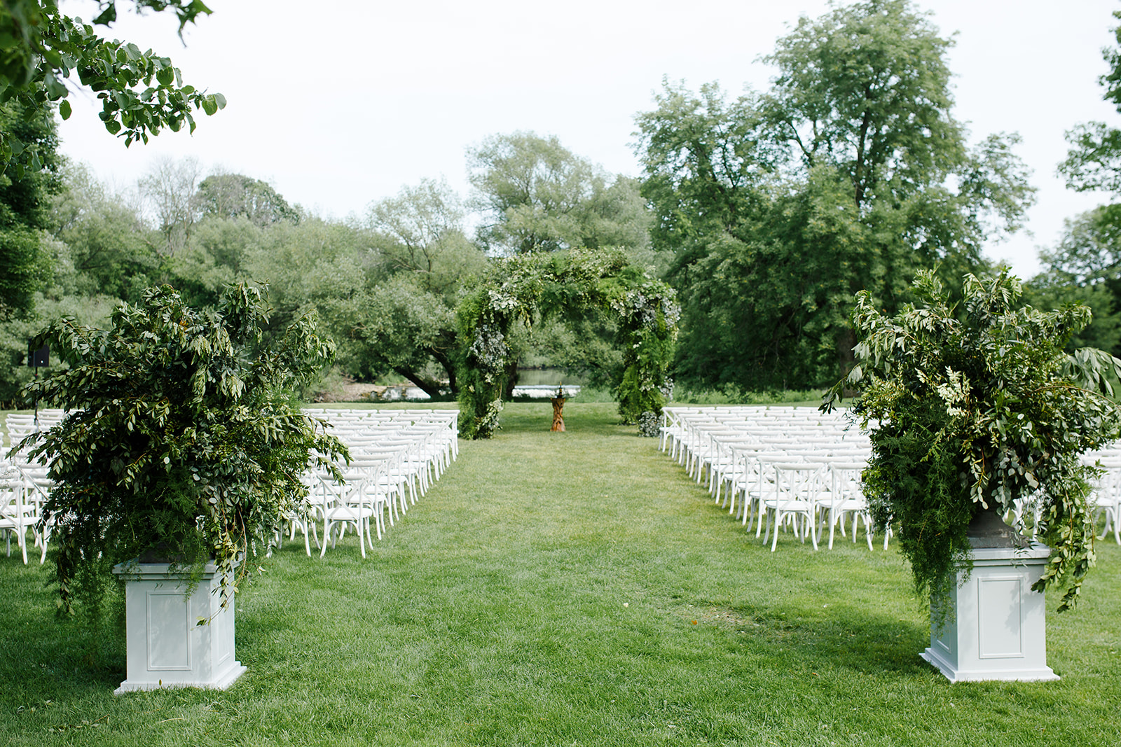 Greenery wedding ceremony outdoor garden design by HMR Designs and Rishi Patel for event in Kohler, Wisconsin
