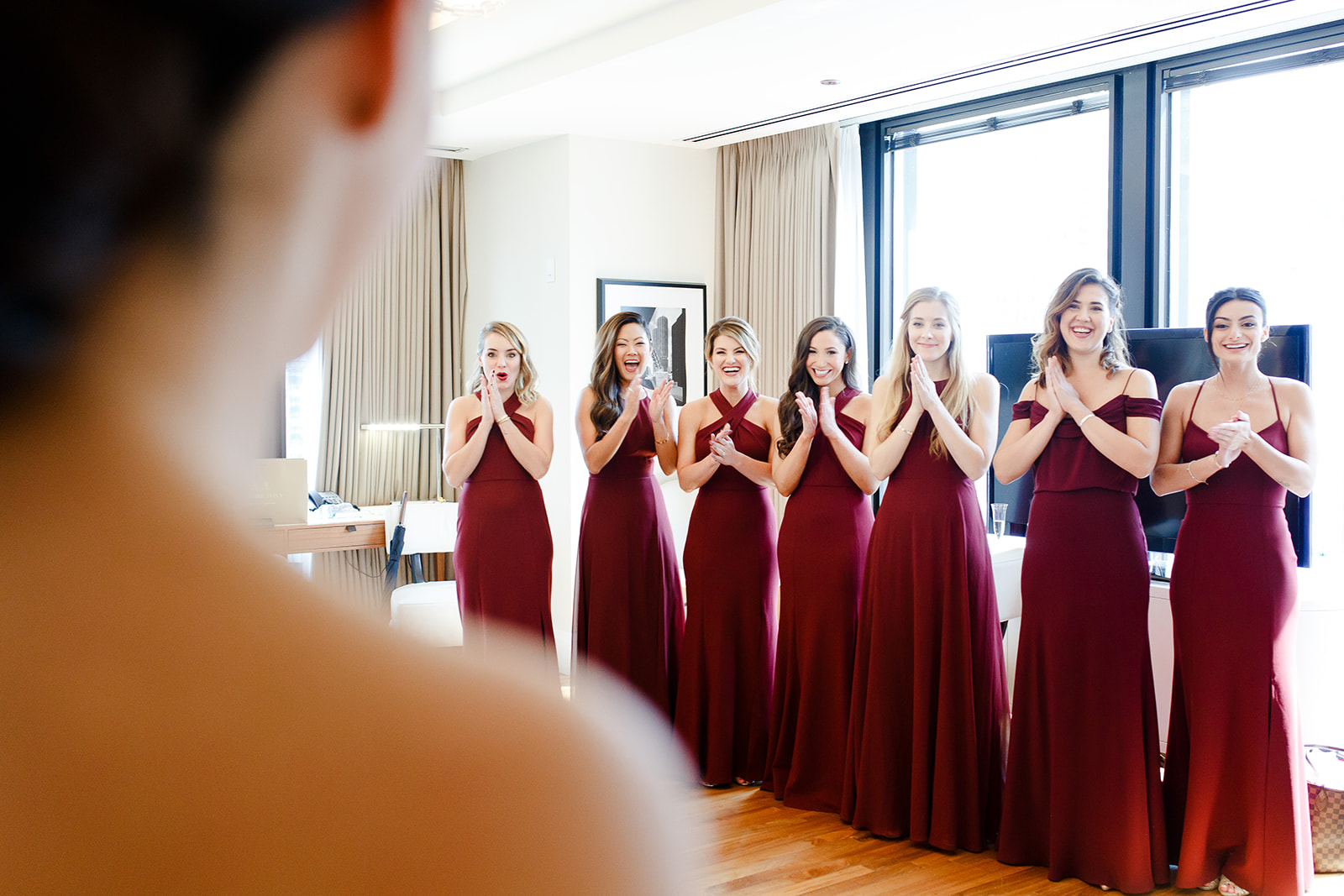 Documentary wedding photography of bride seeing her bridesmaids for the first time on her wedding day in Chicago