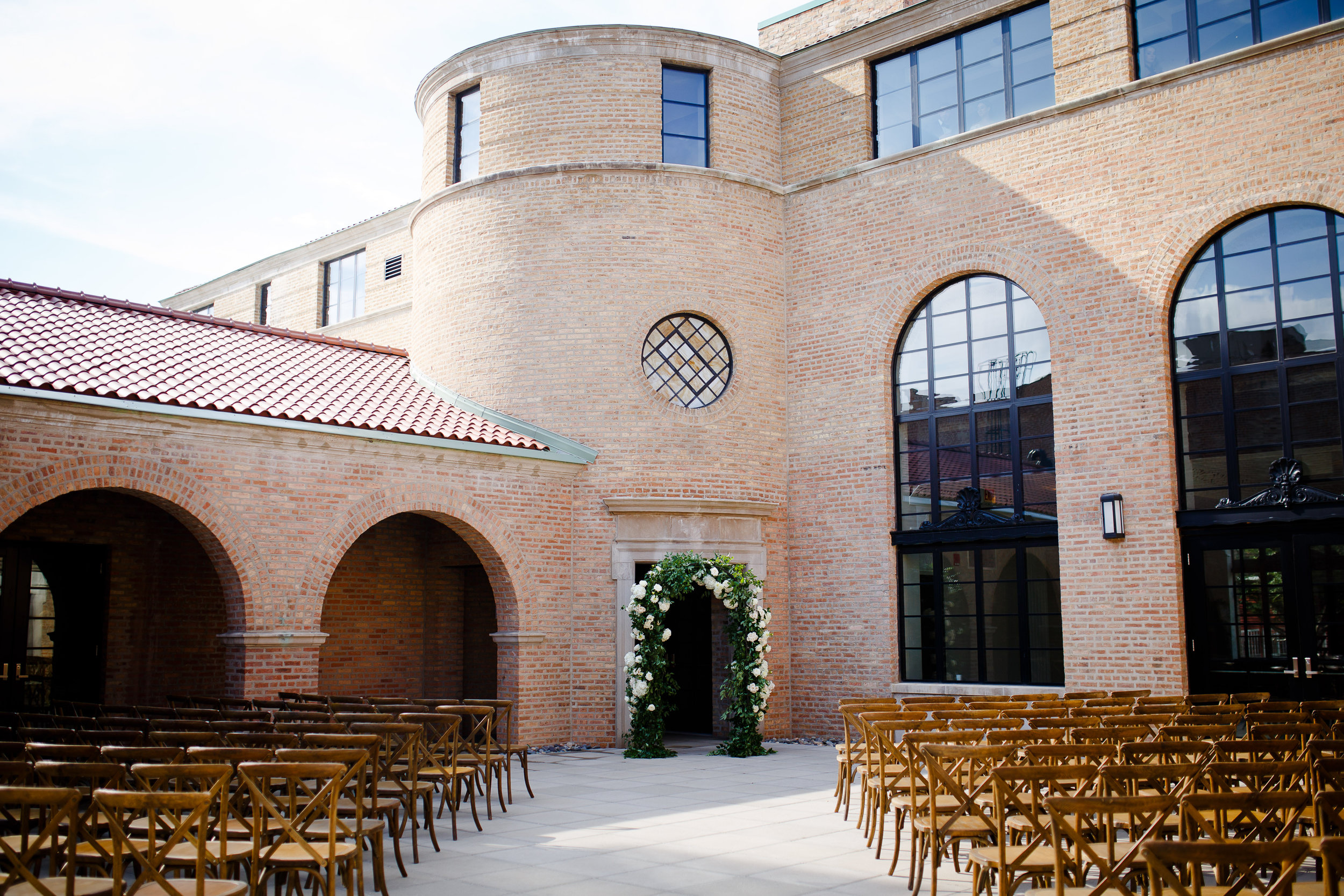 Wedding ceremony setup in the courtyard at Revel Motor Row