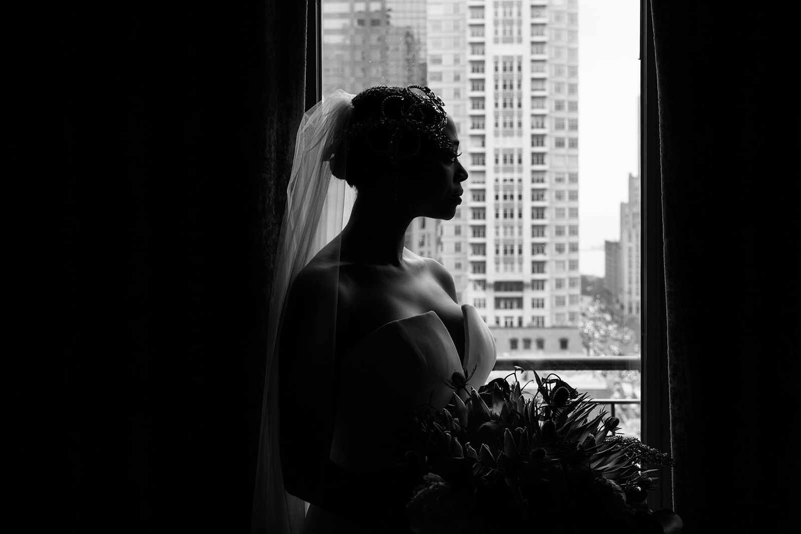 Editorial black and white fashion portrait of an African American bride a the Gwen Hotel in Chicago.