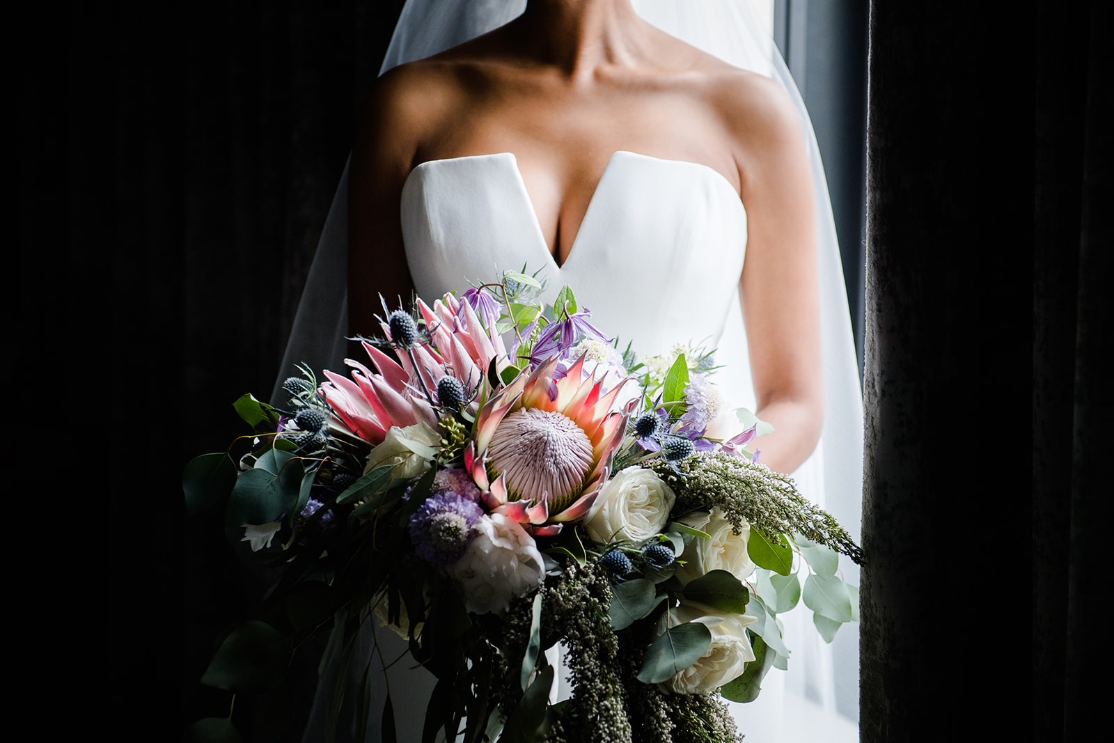 Bride holding her bridal floral bouquet created by Kehoe Designs for her wedding in Chicago at the Art Institute