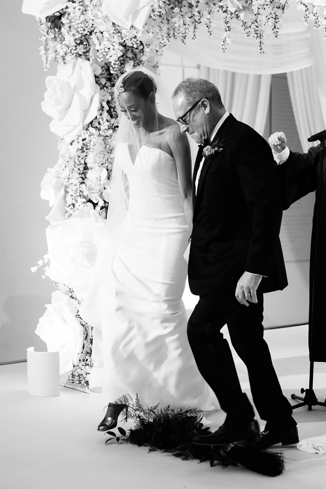 Couple jumps the broom in Chicago at the art Institute during their multi-cultural wedding ceremony.