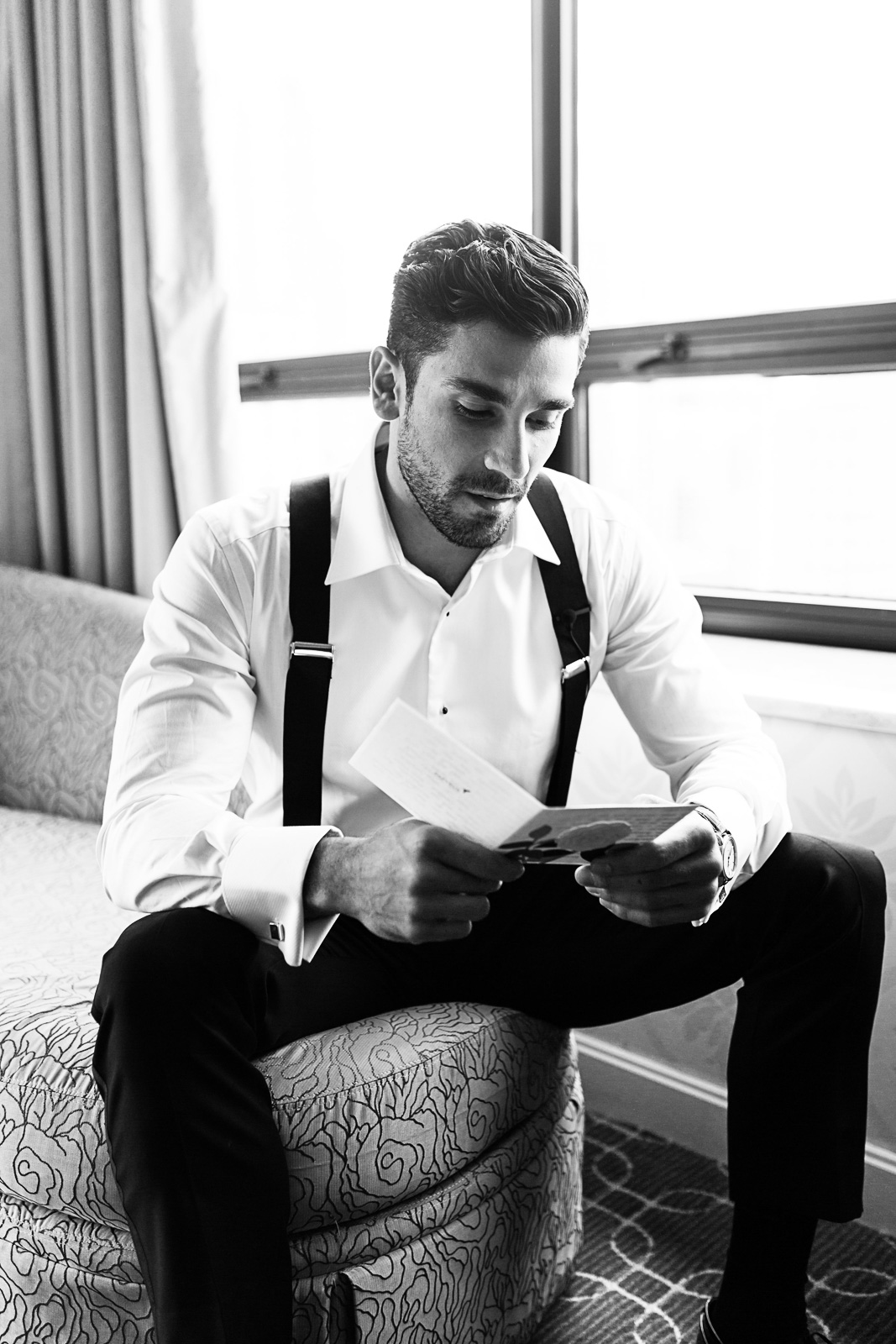 We photographed this groom reading a love note from his bride on the morning of their wedding as he got ready at the Ritz Carlton in the Gold Coast neighborhood of the city.