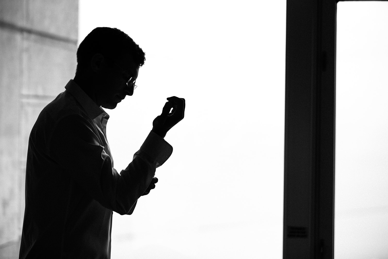 Silhouette getting ready portraits in hotel suites with sweeping windows are always favorites of ours!