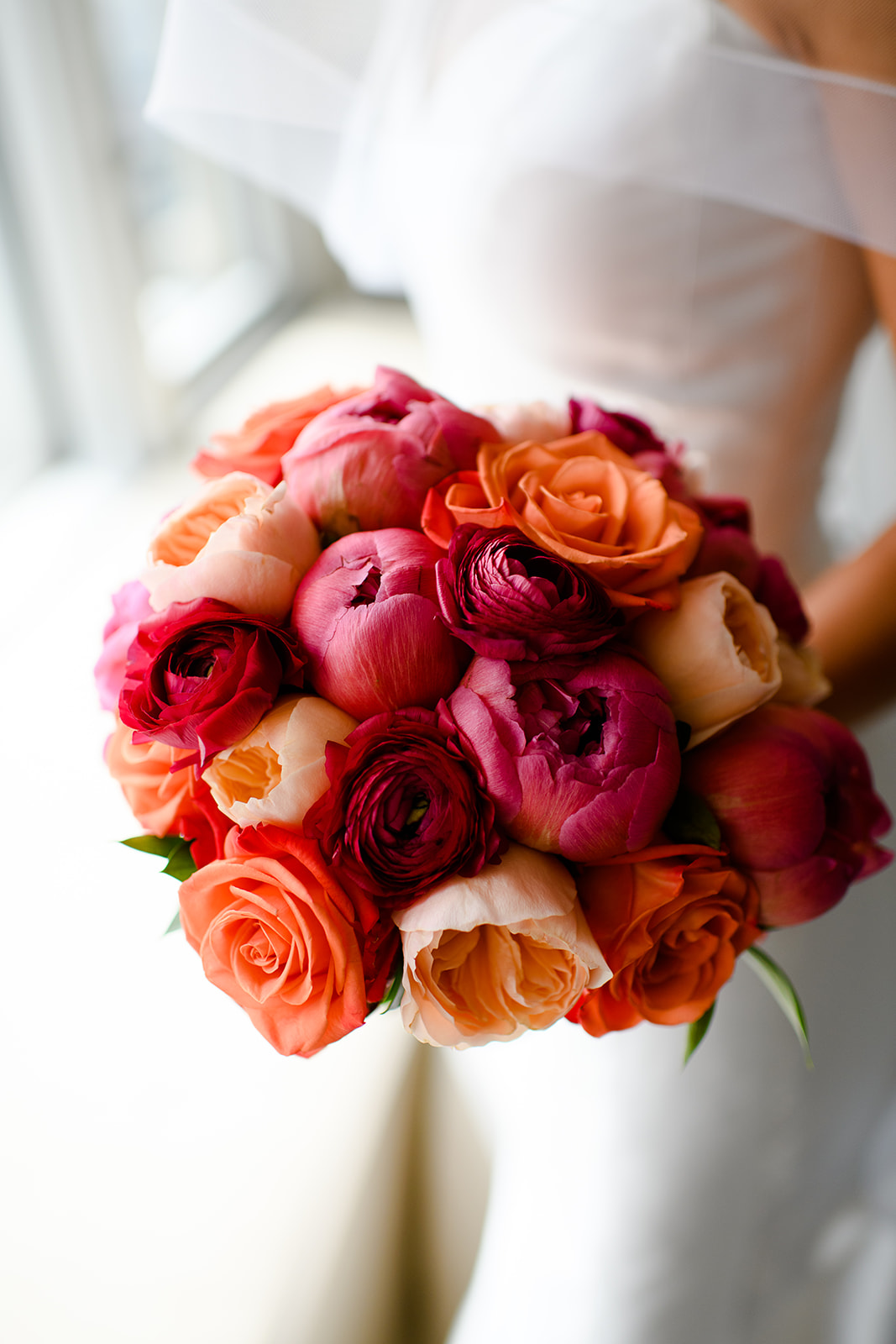 Peony and rose bouquet in bold colors for summer wedding along the lakeshore in Chicago.