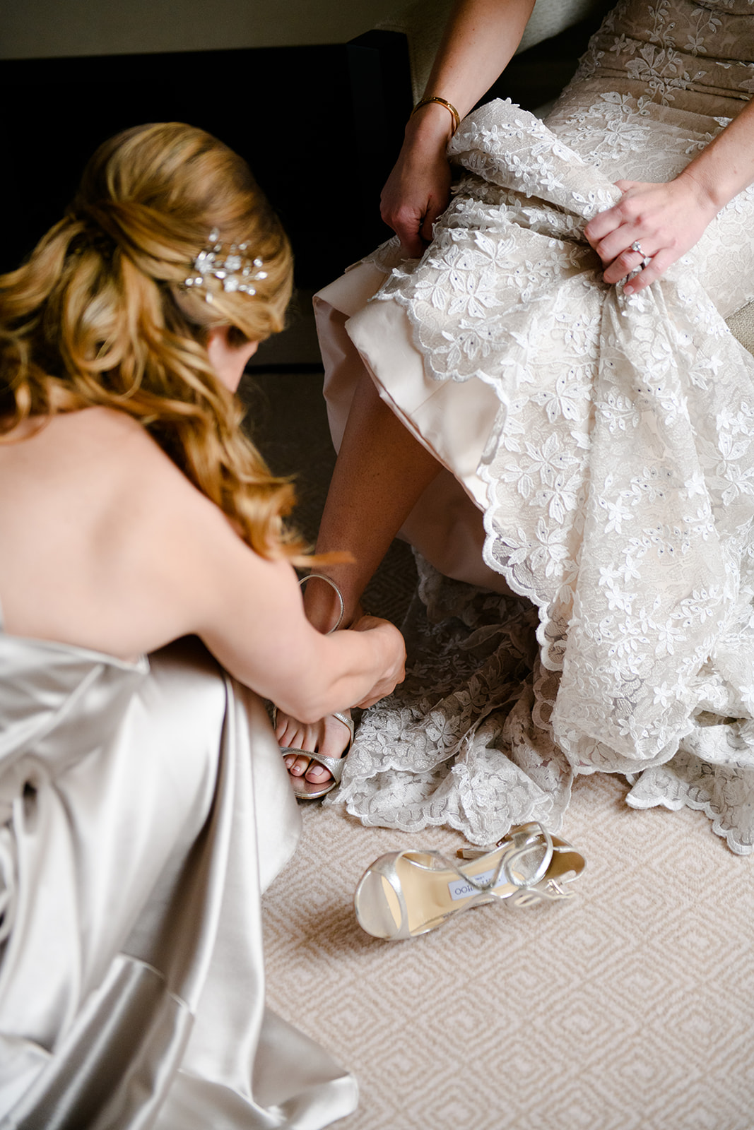 Champagne-colored bridal gowns photograph so beautifully. The charmeuse shell on Claire's gown with the embroidered lace overlay has such beautiful texture. She dressed her bridesmaids in dove gray which is a beautifully complementary color to the champagne wedding gown.