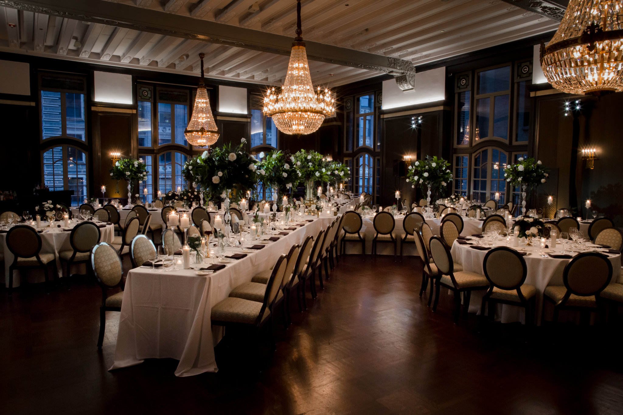 The dining room layout was a unique x shape created with long tables. The bride and groom were seated at a sweetheart table decorated with cascading florals.
