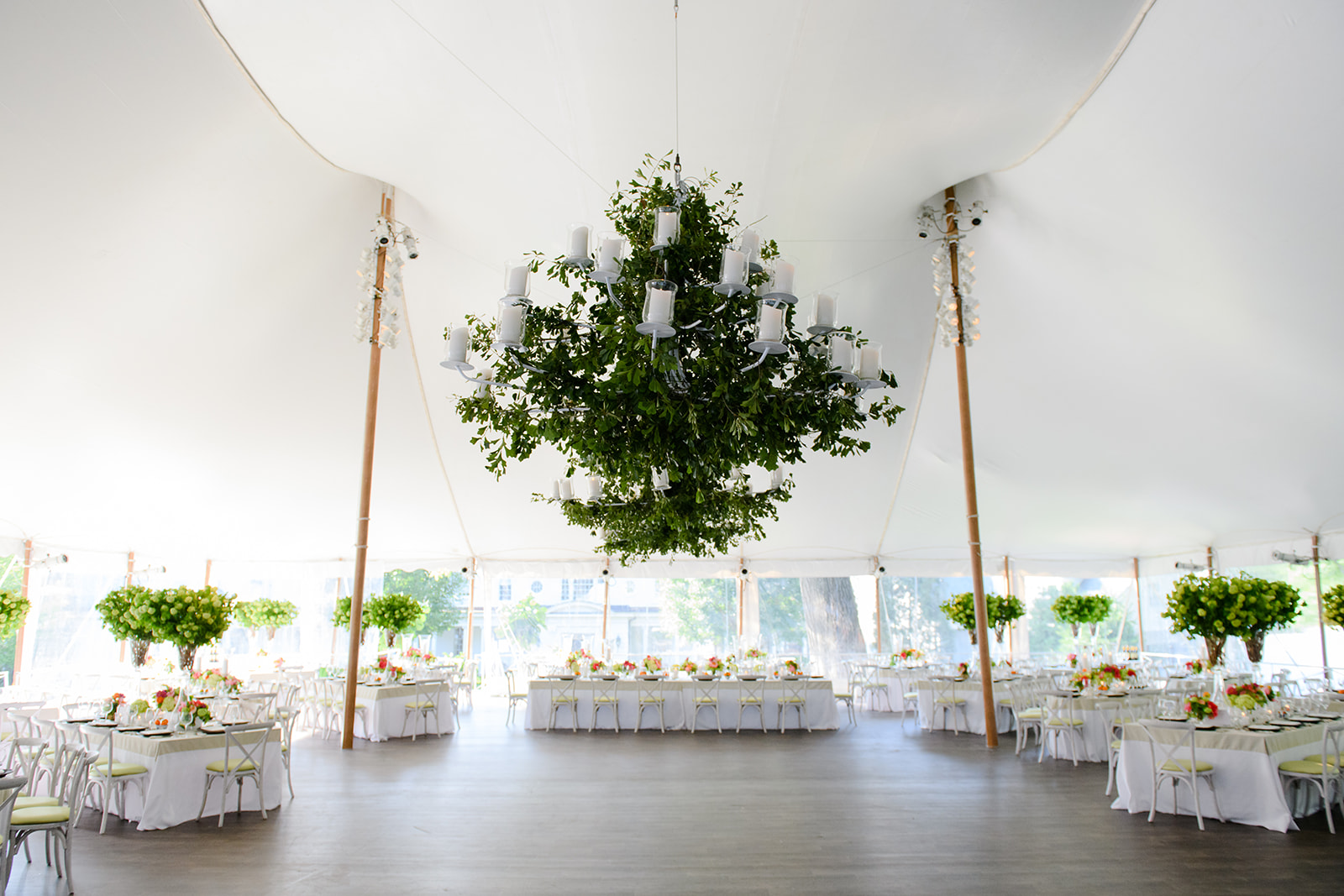 Marina Birch, of Birch Design Studios, and Rishi Patel, of HMR Designs are our design and planning dream team! We're swooning over this bright and colorful summer dinnerscape. Hydrangeas, tangerines, lilies, peonies, and other bright florals filled the sweeping tent with color.