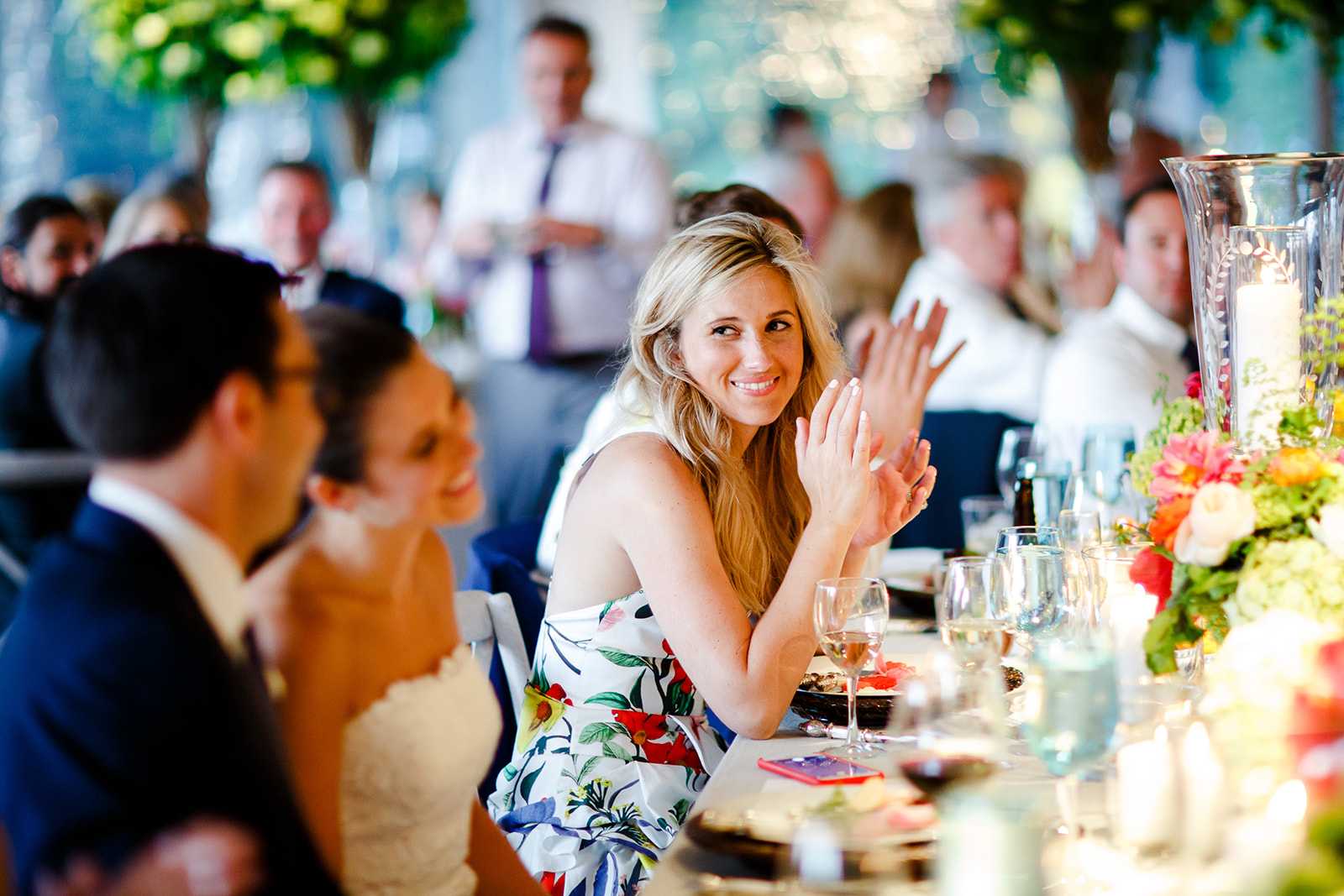 The couple's family were all very close and it was so evident both while being present with them on the wedding day and also in the wedding photos. We love this shot of the bride's sister at dinner during their dad's toast.