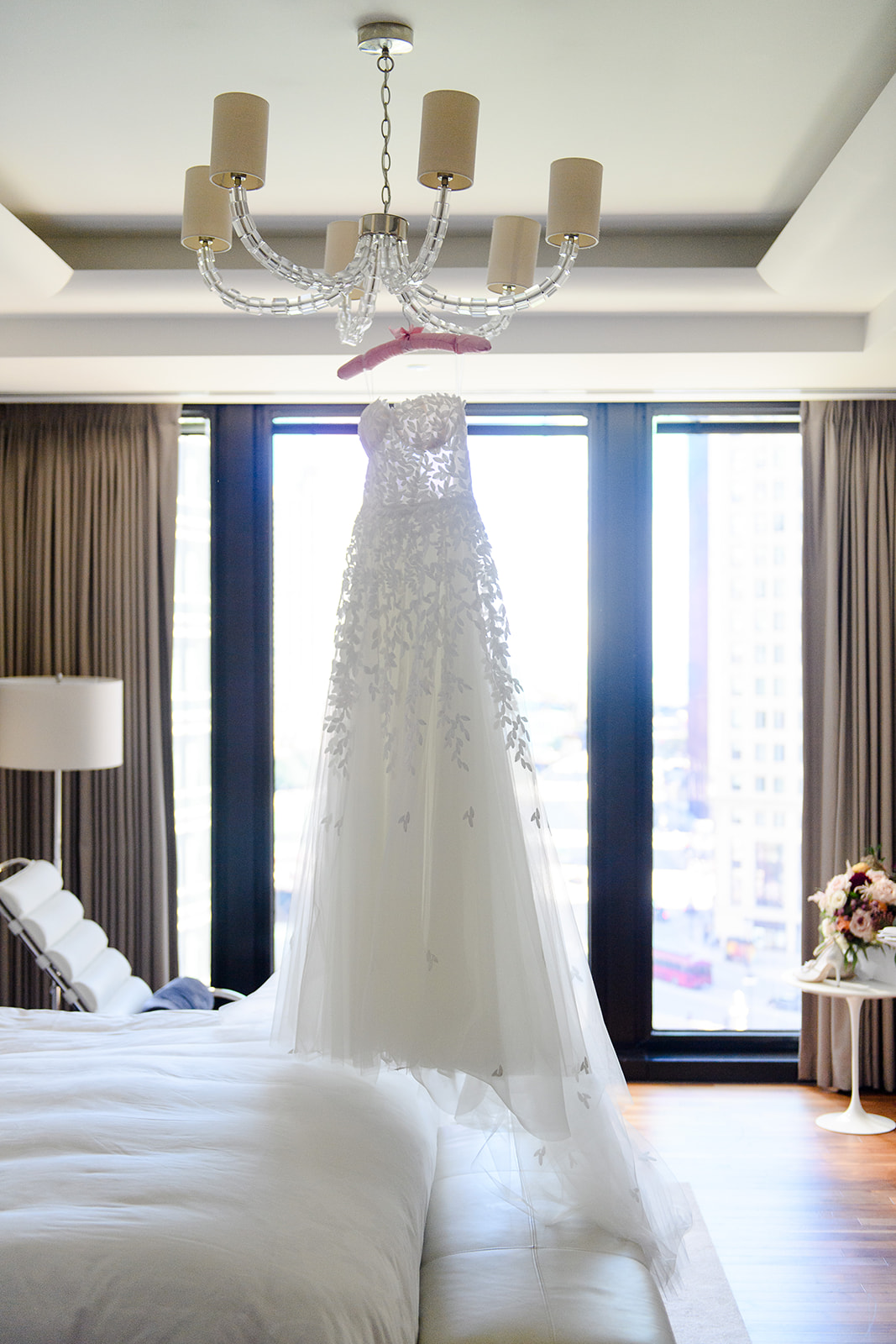 """Chandeliers, candles, lush and textured Fall floral, rows of tress, and a warm cozy loft. Sarah got exactly what she always dreamt of for her wedding...at least according to her mom's memory of her childhood wedding drawings """"with all the chandeliers!"""" Bridgeport Art Center's Sculpture Garden Venue provided the perfect loft space and attached outdoor ceremony courtyard."""