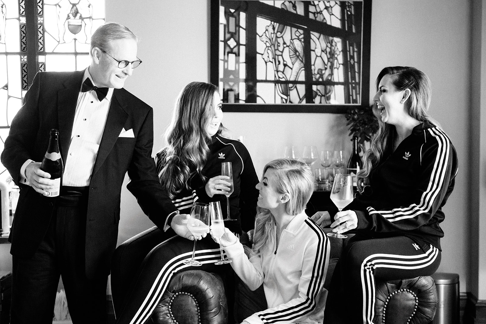 Who wouldn't love a bride who gets ready in matching Adidas track suits with her family and bridesmaids instead of silk robes? They're the coolest.