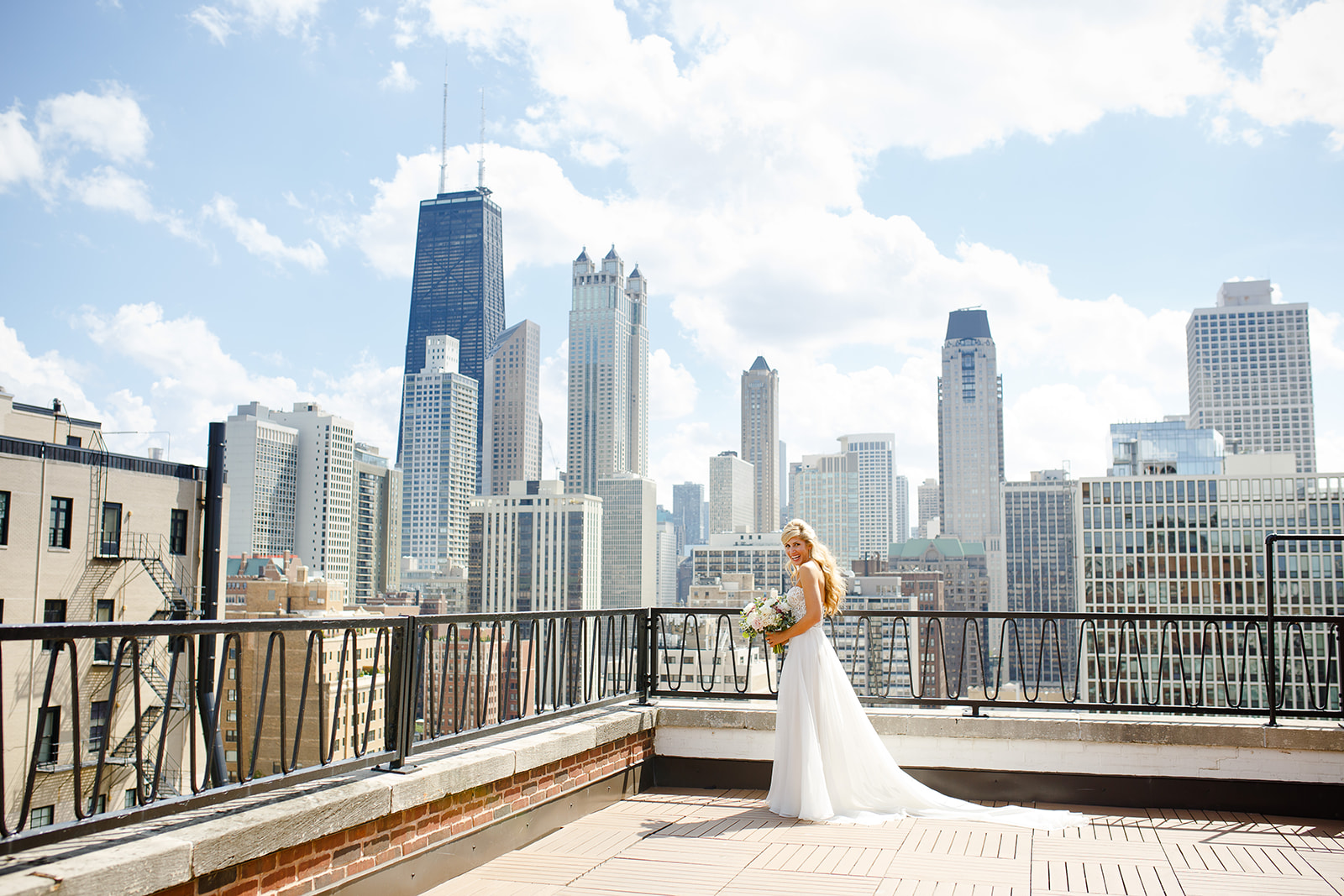 The bride looked stunning here on the rooftop of the Ambassador hotel. The couple loves Chicago's rooftops and knew they wanted their wedding to incorporate some of their favorite spots and treat their guests to the setting of a Chicago summertime reception under the stars and city lights.