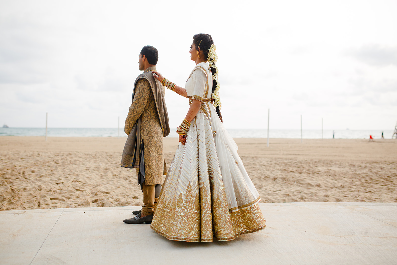 We planned the first look to happen right on the shores of Lake Michigan. A short walk from the Drake, Nandhini tapped Vamshi on the shoulder as they saw each other in their wedding day ensembles for the first time.