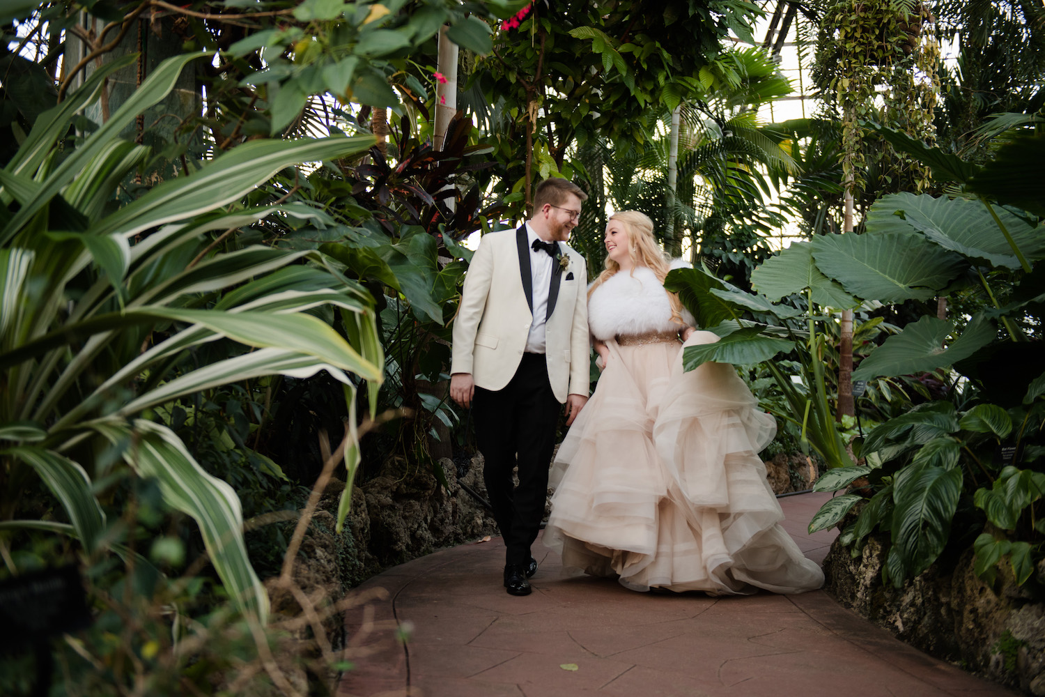 Lincoln Park Conservatory is the best downtown wedding photo location for chilly winter wedding days when you want to stick to the north side of the city. Other alternatives would be the Art Institute, Lyric Opera, or Union Station, but for weddings at hotels like the Peninsula, Ritz, or Four Seasons, it just makes sense to hop up to Lincoln Park. The diversity of backdrops available here is fantastic as well since you can make use of the conservatory as well as the outdoor gardens and promenade and also have the skyline backdrop right at your fingertips.