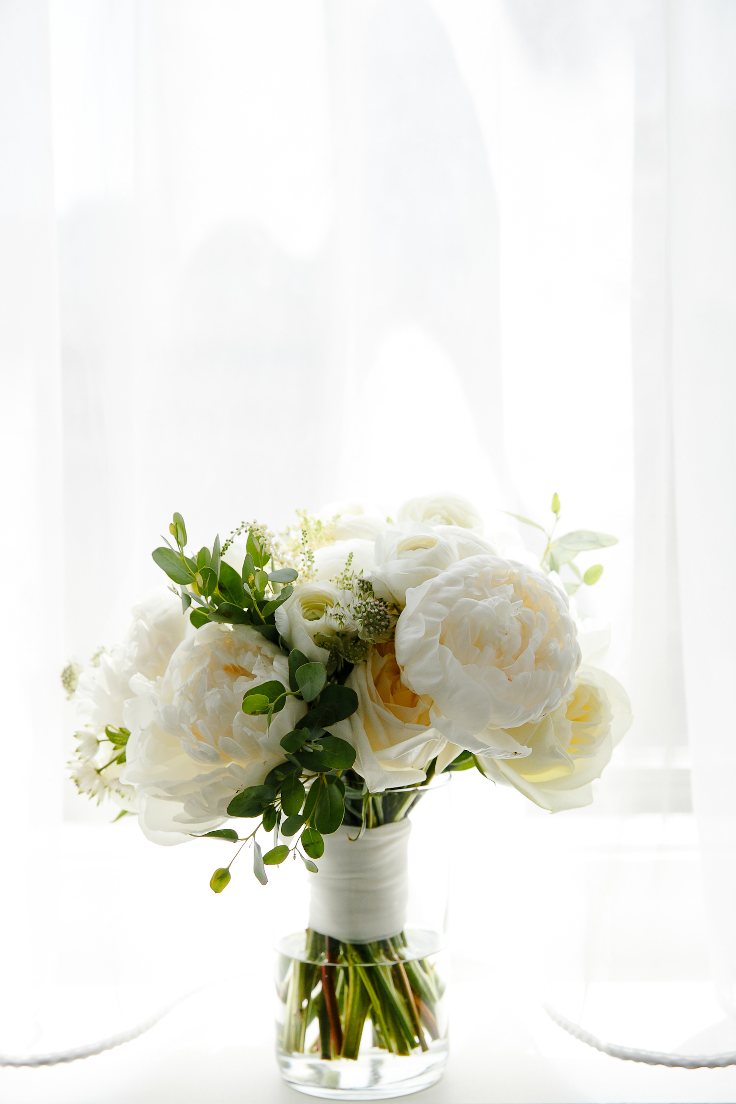 Classic peony and rose wedding bouquet for black tie Chicago wedding.