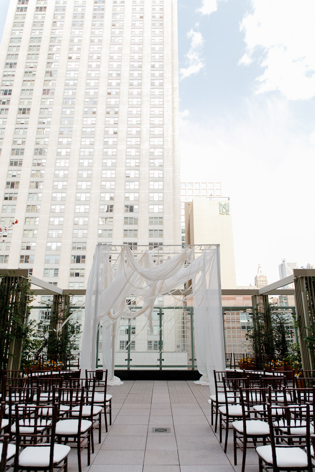 Draped wedding chuppah for a stylish wedding ceremony at the Peninsula Hotel's terrace rooftop.