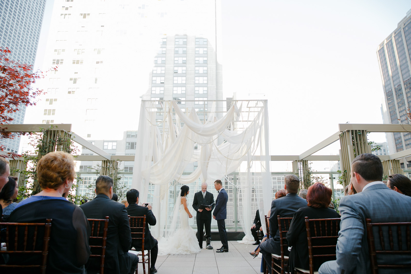 Wedding ceremony on the terrace at the Peninsula Chicago.