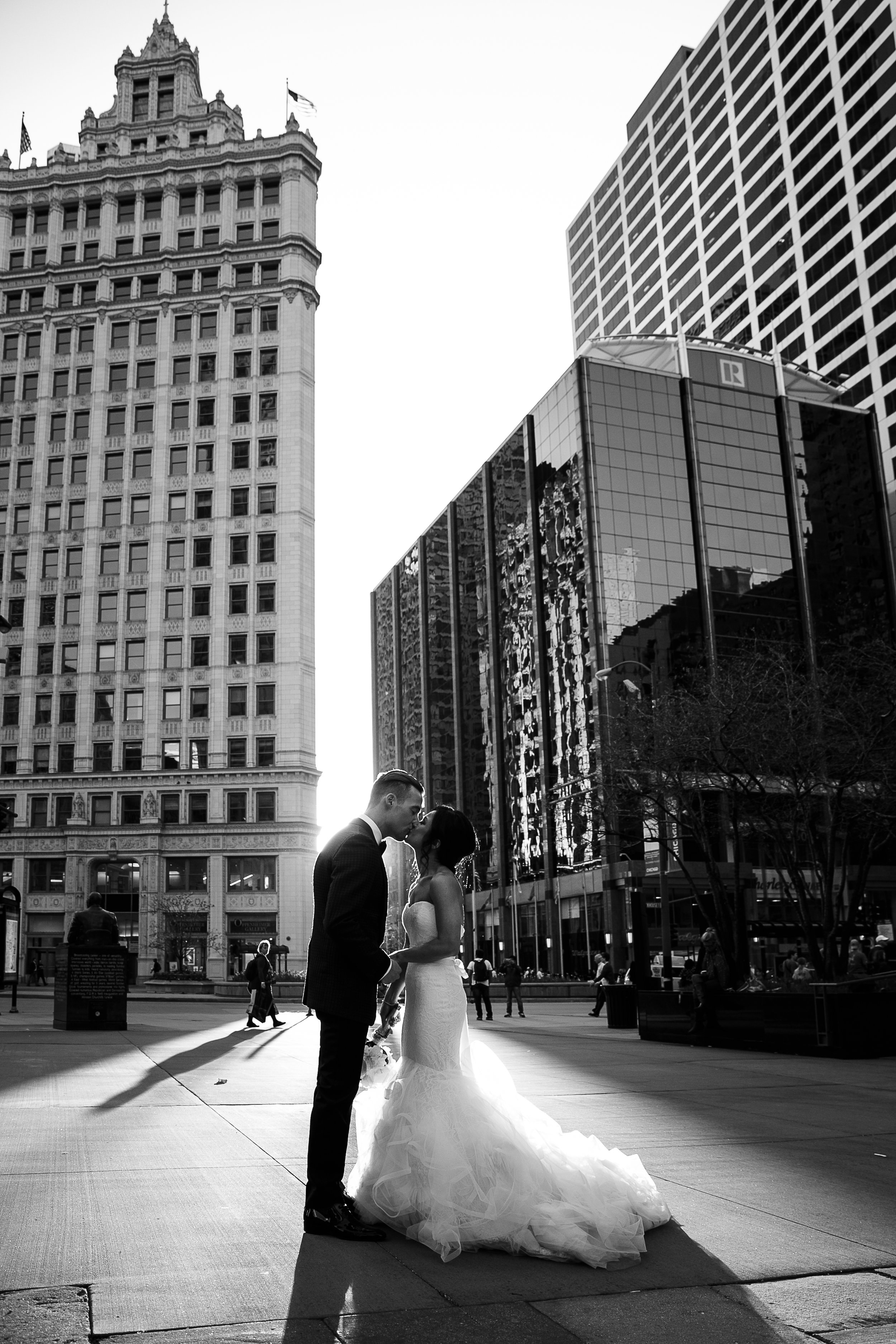Iconic Chicago architecture is the backdrop for this editorial wedding portrait on Michigan Ave