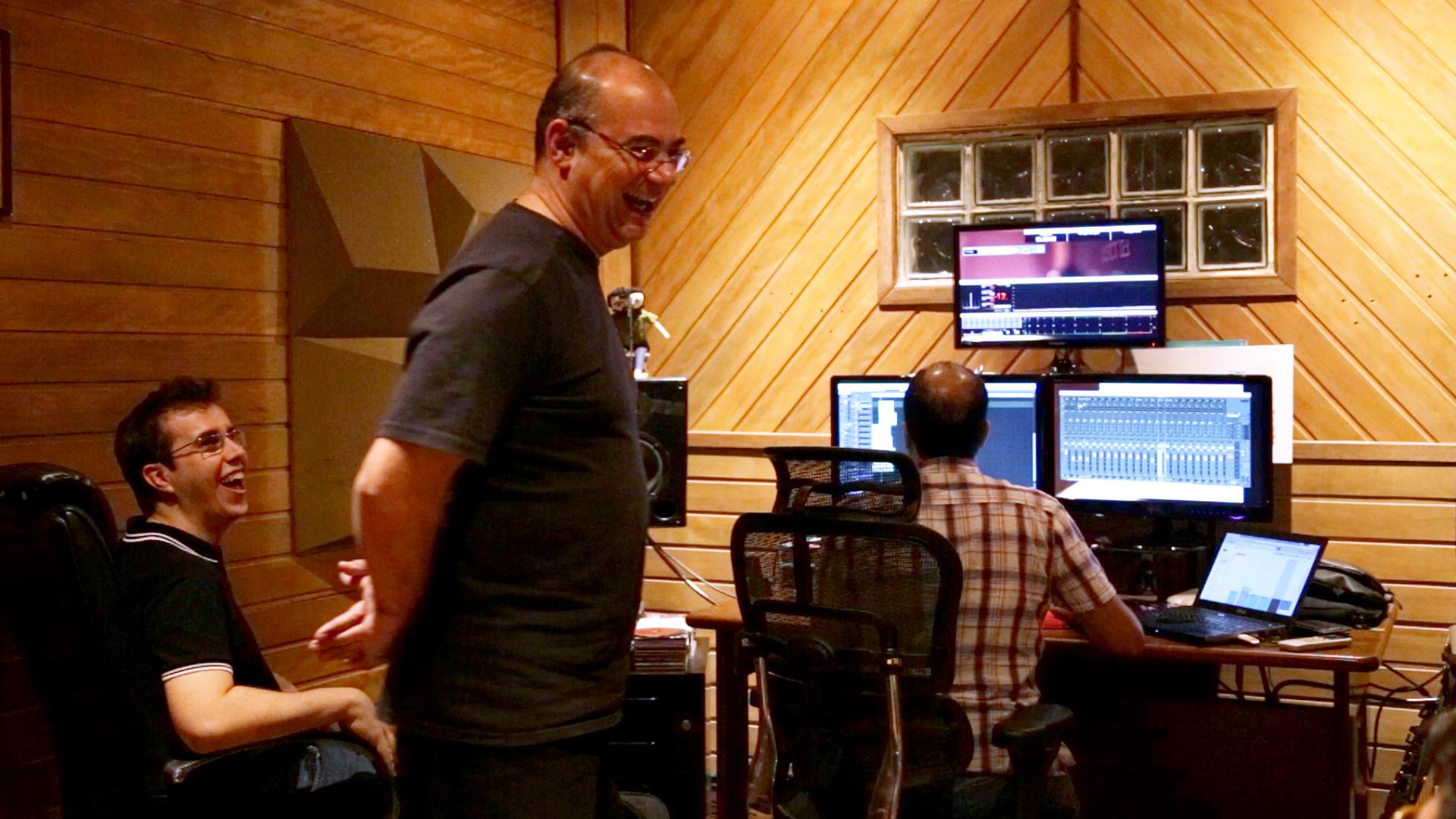 Paulo Braga and Rafael Piccolotto de Lima listening takes.