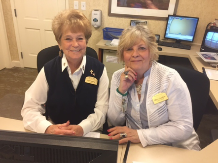 Lori Nutting, Receptionist, left, started when the community opened in 1991. She and Mary Dugdale, Senior Concierge, are among the 120 friendly faces greeting everyone at New Pond Village.