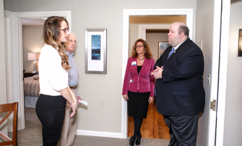 Tasha Thomas , memory care director; John Tincler, resident association president; and  Susan Cwieka , campus executive director; describe for Sen. Feeney the amenities and focused approach in constructing the new Memory Care Center.