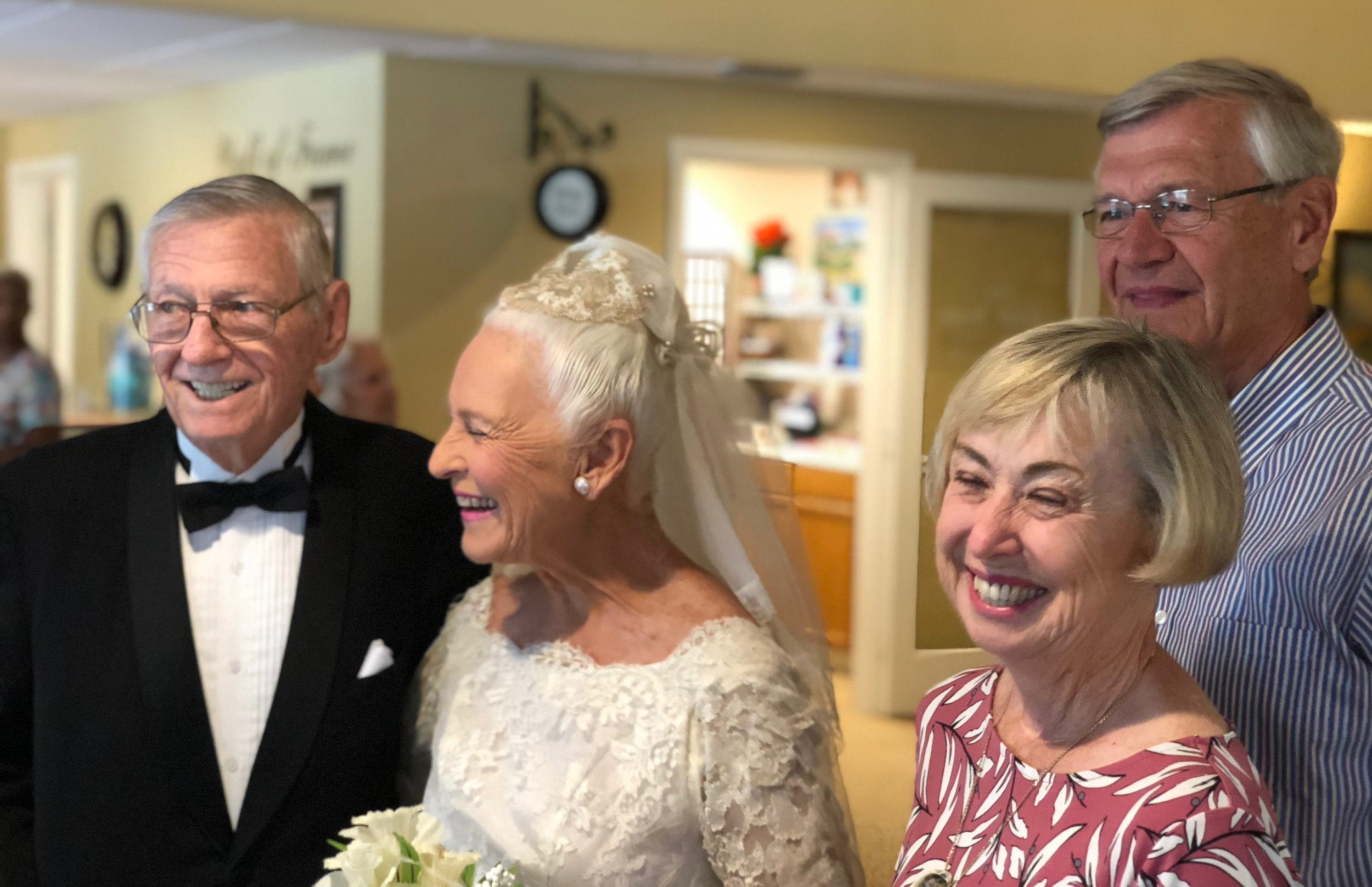 "Since their wedding day, Charlie has called Gail his ""beautiful bride."" Here, Charlie watches his bride enter the room along with his oldest daughter, Michele, and grandson Liam."