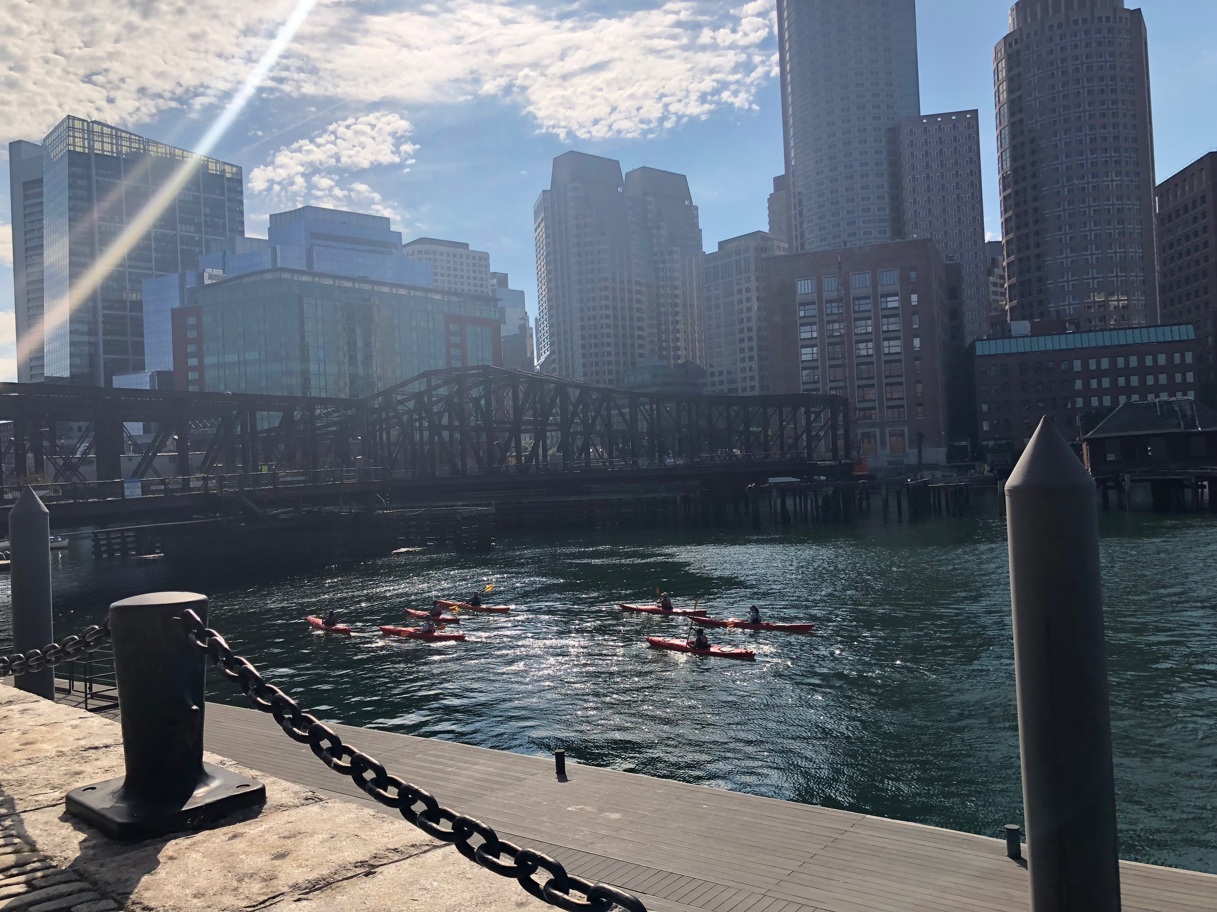 """Cohort 1 went on a kayaking excursion in Boston Harbor, a """"spark experience"""" that became a touchpoint in conversations about curriculum planning throughout the year."""