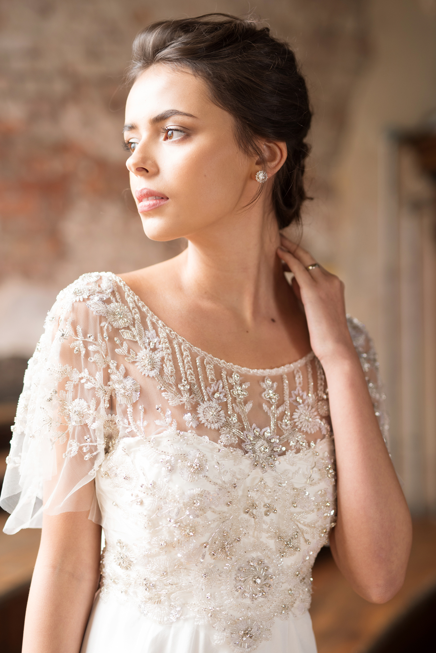 Adele Dress - A distinctive, hand-embellished illusion neckline, softly draped sleeves and open back, the romantic Adele brings a sense of effortless elegance... Styled with the Valencia Stud Earrings.