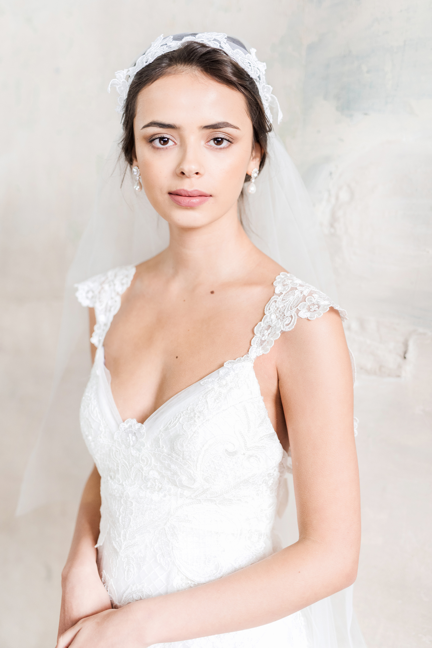 Savannah Dress - Full of whimsical romance, the sequin-highlighted tulle of the Savannah is charming and feminine. With an open v-shaped neckline, shoulder drapes of sequinned lace that extends into an open, low back, and a detailed lace belt, the Savannah exudes bridal grace.Styled with the Valencia Pearl Drop Earrings.