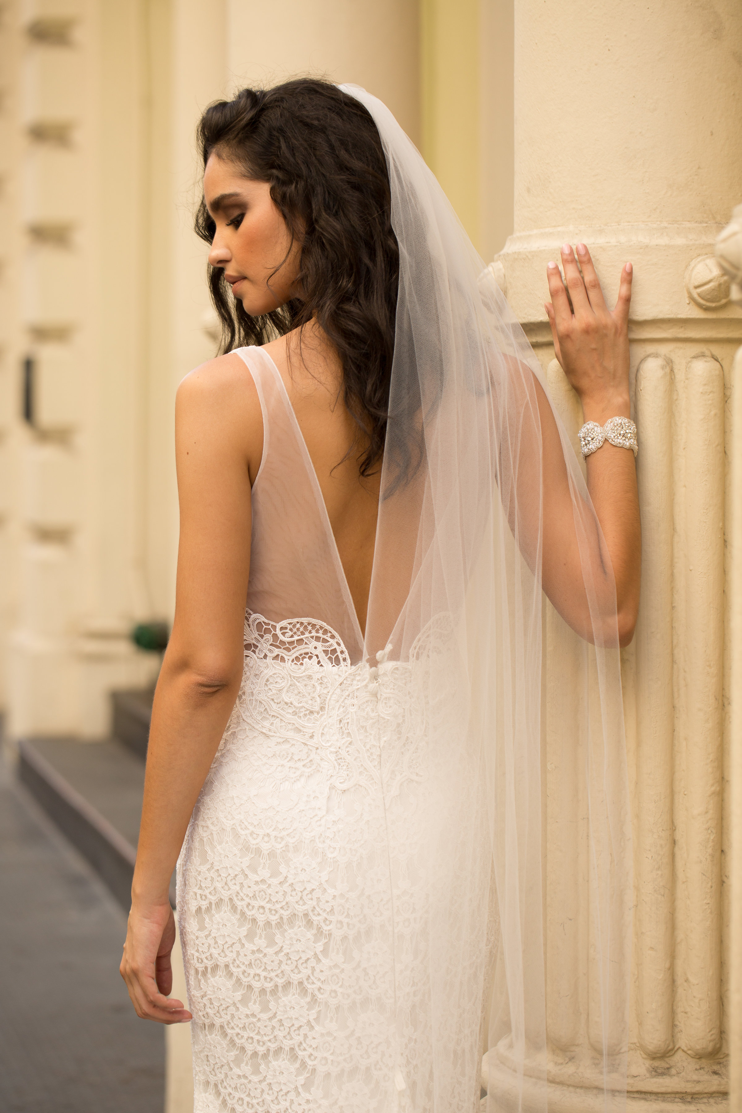 Saasha Dress (Non-Embellished) - Understated romantic details, such as a soft ivory lace and sheer tulle shoulder and back details, make this non-embellished Saasha dress the perfect option for a modern Anna Campbell bride.Styled with the Zara Chapel Length Veil.