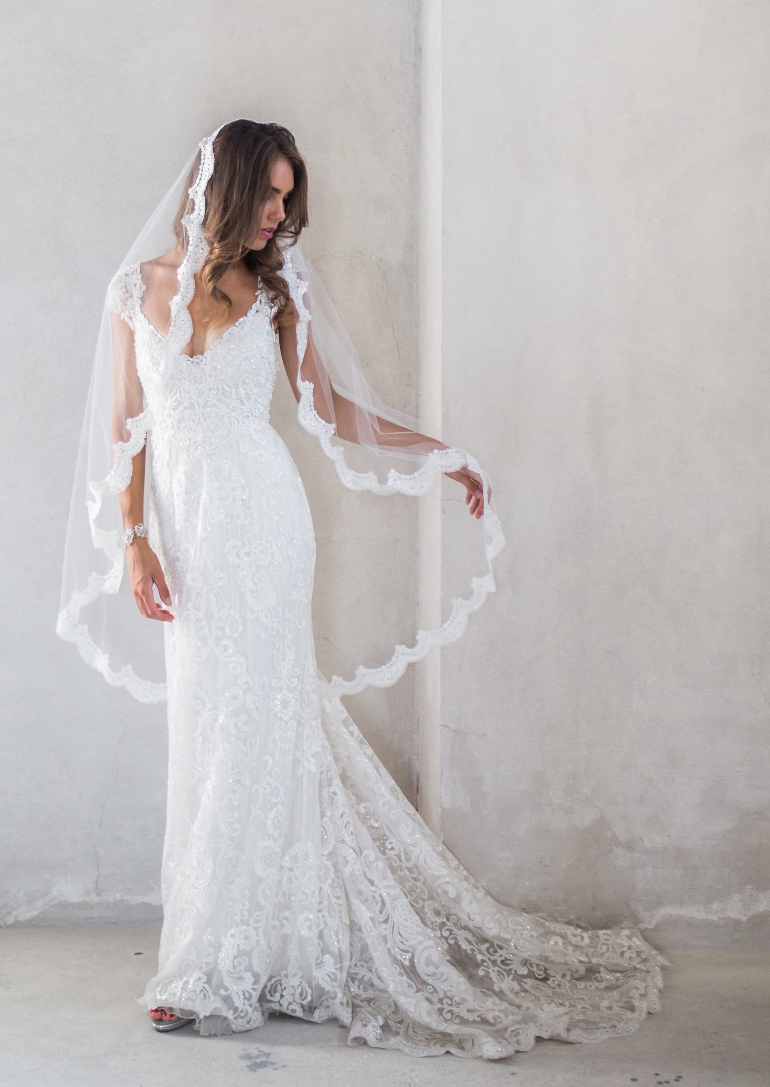 3. How long are your veils? Does my veil need to match my train? - Our veils are designed in Fingertip and Chapel lengtha:Fingertip veilVeil length = 135cm (53 inches)Fingertip veil with blusherVeil length = 140cm (55 inches)Blusher = 85cm (33 inches)Chapel veilVeil length = 215cm (85inches)Chapel veil with blusherVeil length = 215cm (85 inches)Blusher = 85cm (33 inches)While the majority of our brides choose the chapel length option, it will always depend on your dress, and your unique style! Your veil doesn't need to be the same length as the train of your dress, and because our veils are made from a very sheer tulle, all of the detail of your dress will still be visible and beautiful through the veil tulle.Pictured: The Alyssa Dress, styled with the Alyssa Veil (Fingertip Length, No Blusher) Photo by White Images