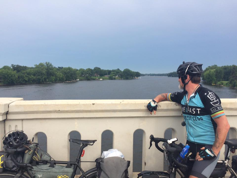 Mike Robertson looking into the water crossing the Mississippi River