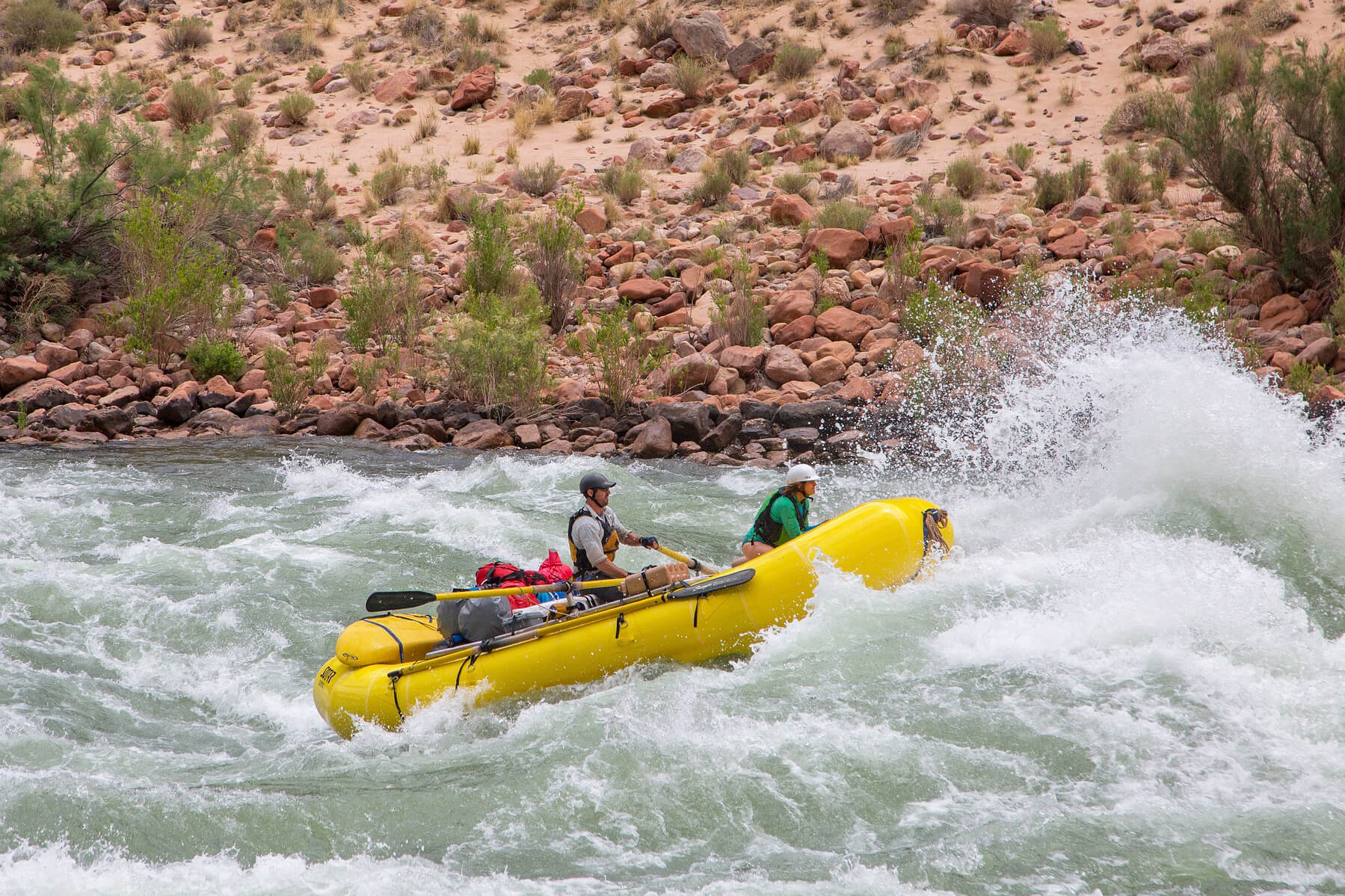 a couple white water rafting exploring outdoor date ideas