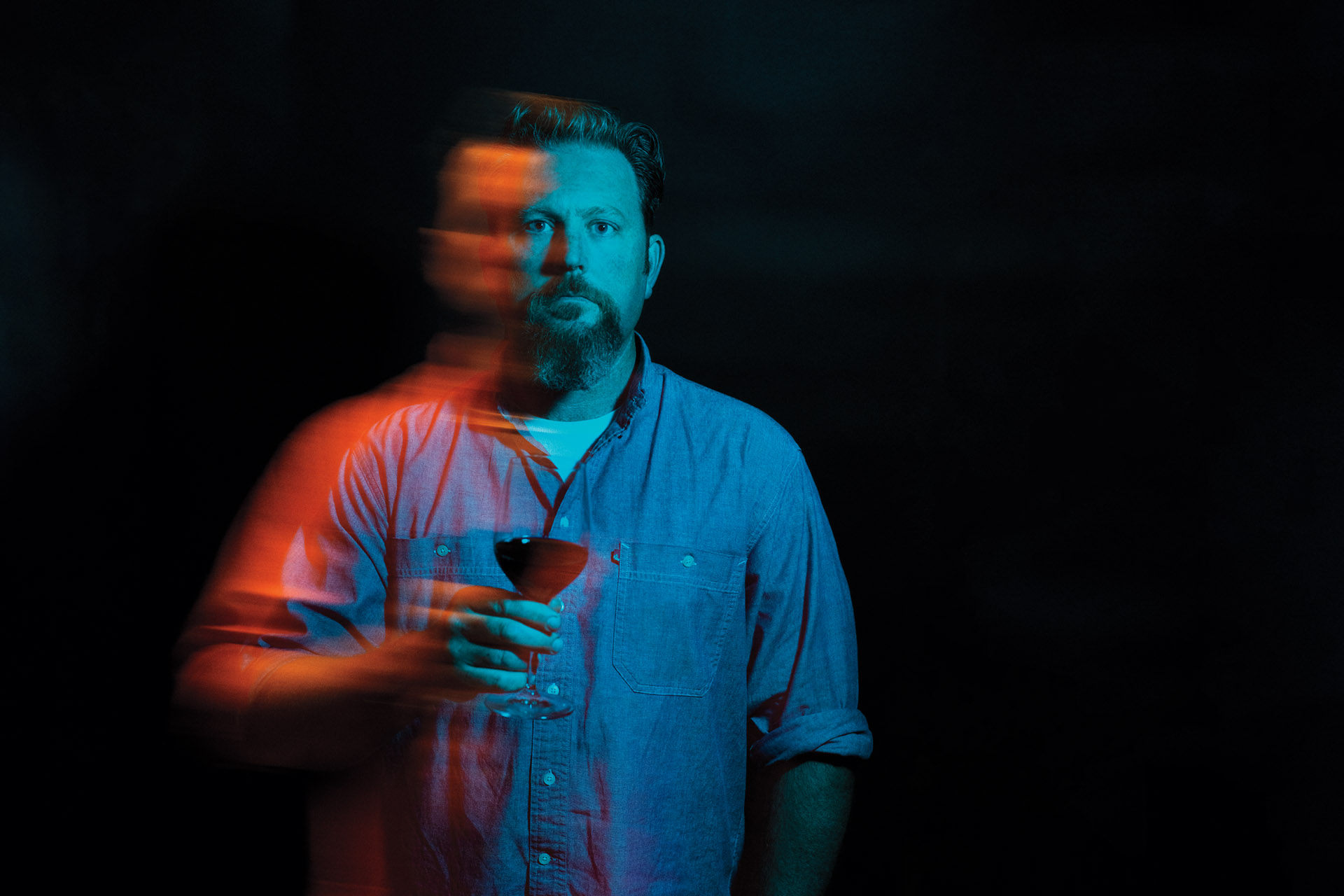 Herb Quady holding wine glass