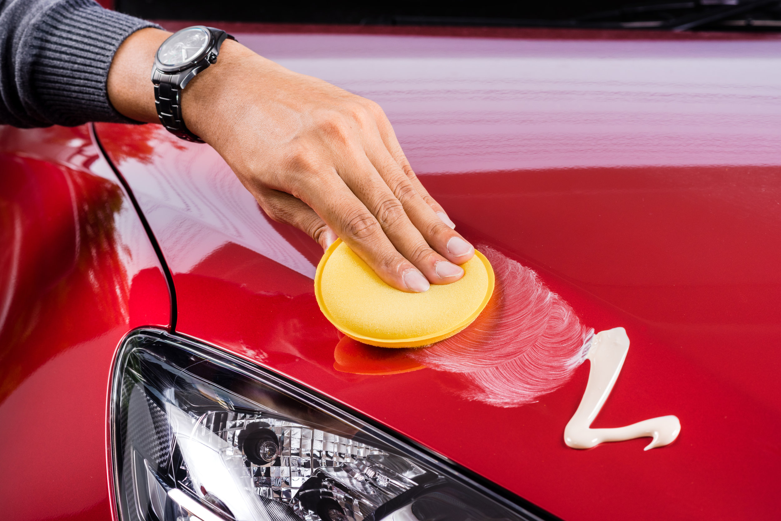 applying polish on car