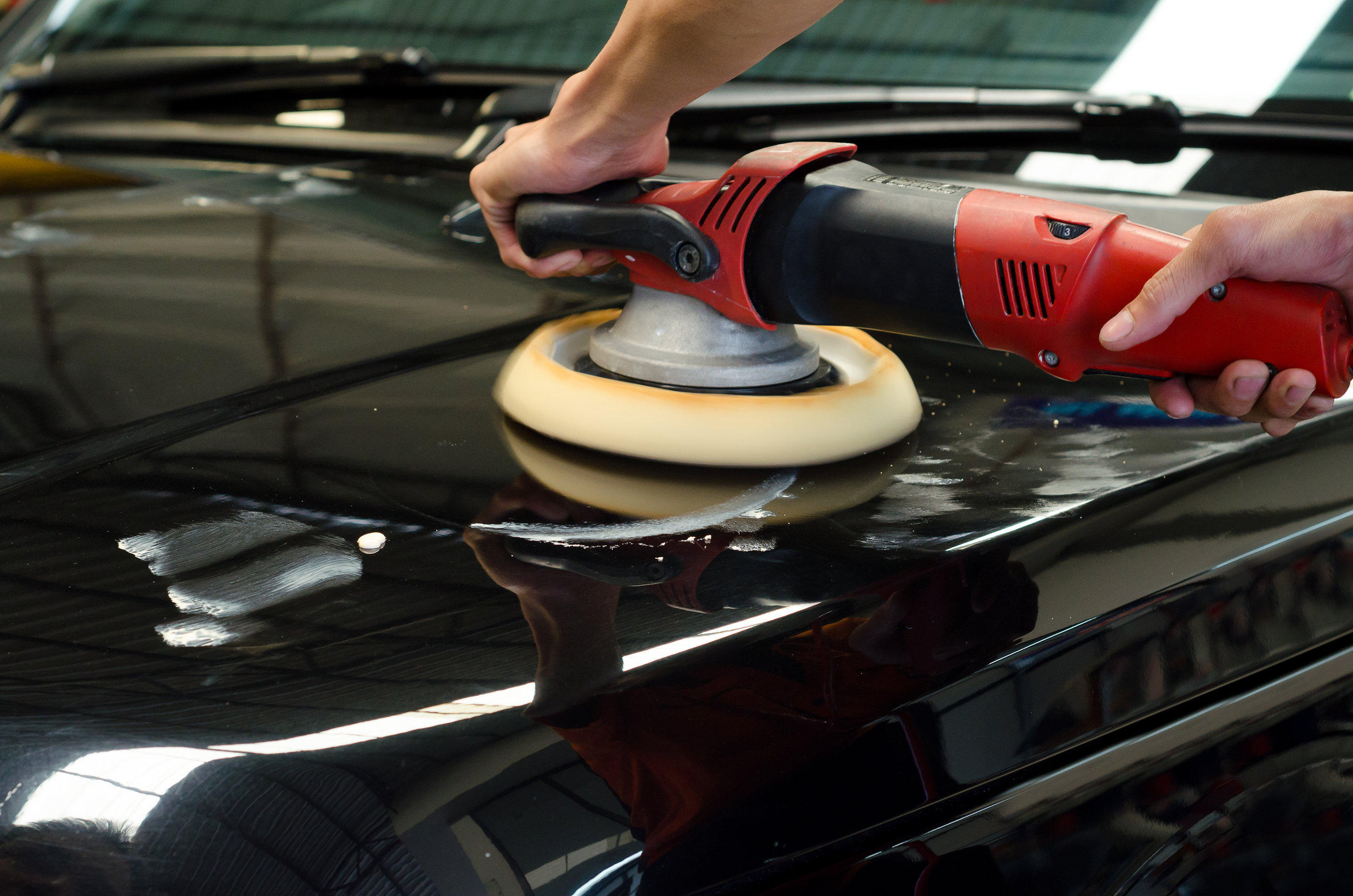Car Detailing, Polished Black Car By Polishing Machine.